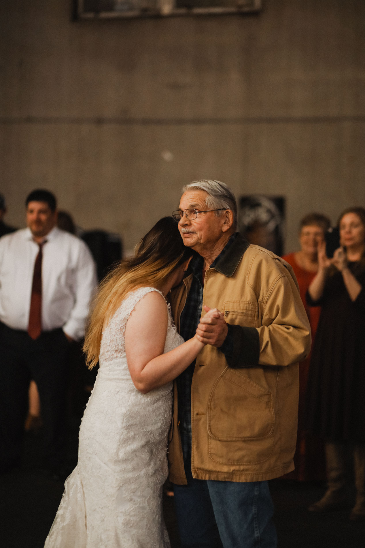 bride and grandpa sharing a dance at wedding