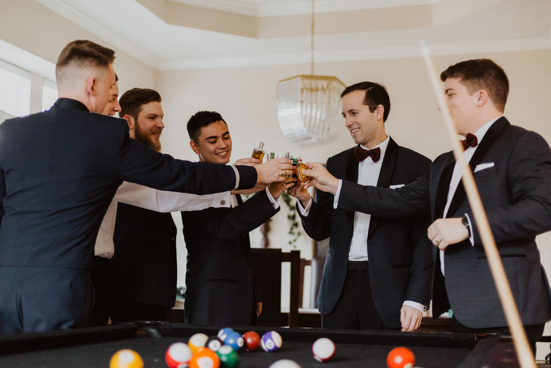groomsmen talking a shot before wedding day begins
