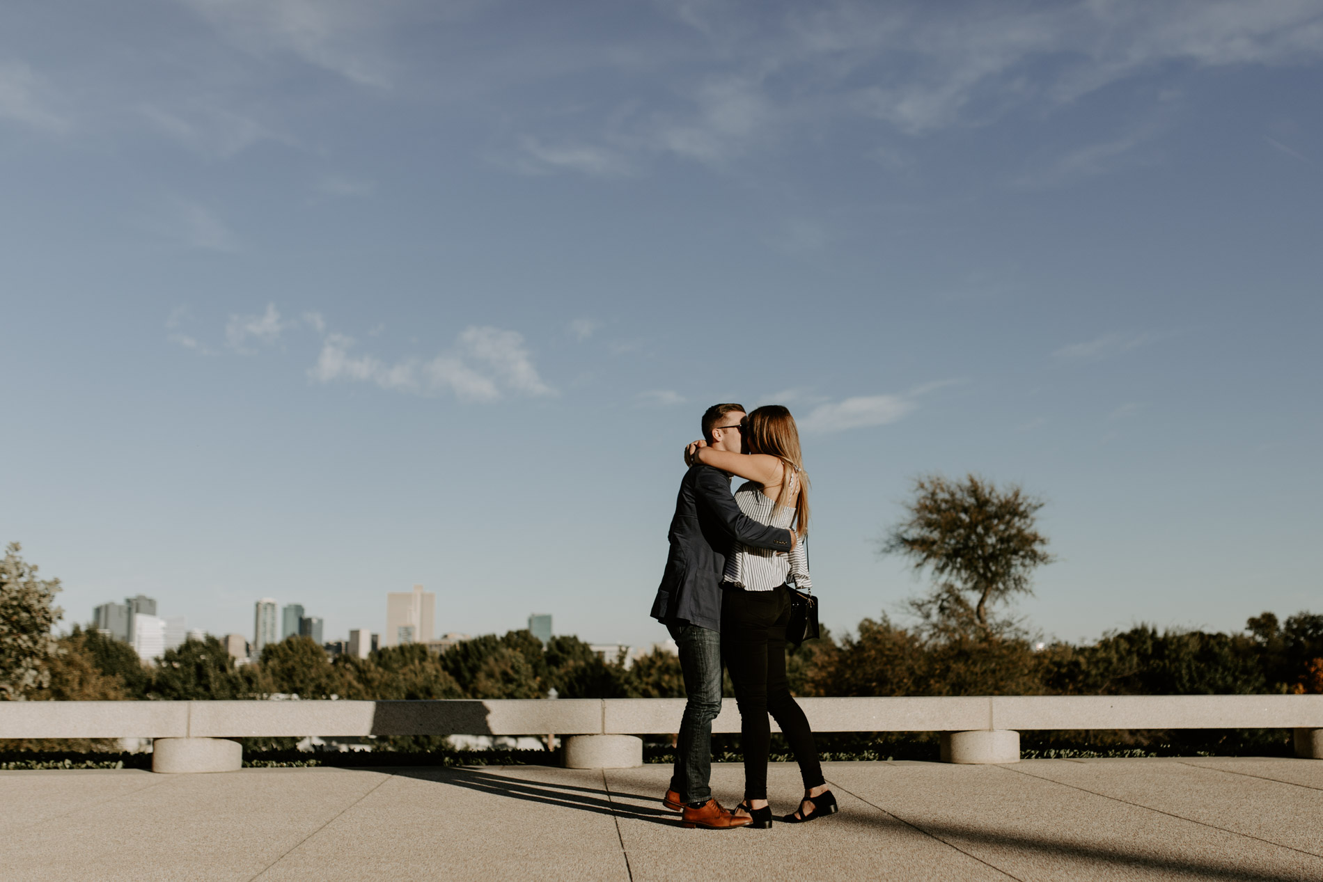 Couple hugging immediately after getting engaged in Fort Worth