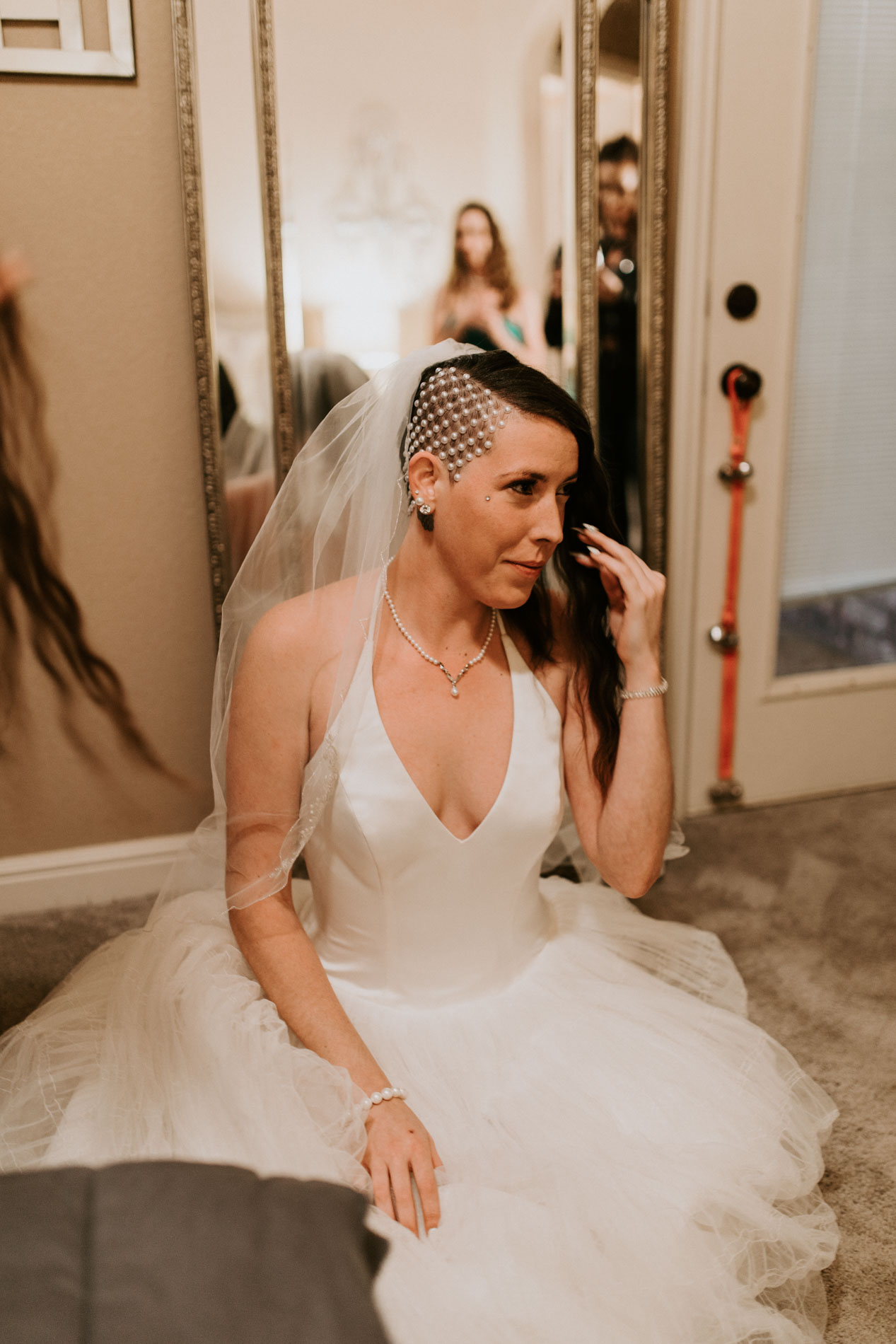 bride getting ready for outdoor wedding ceremony