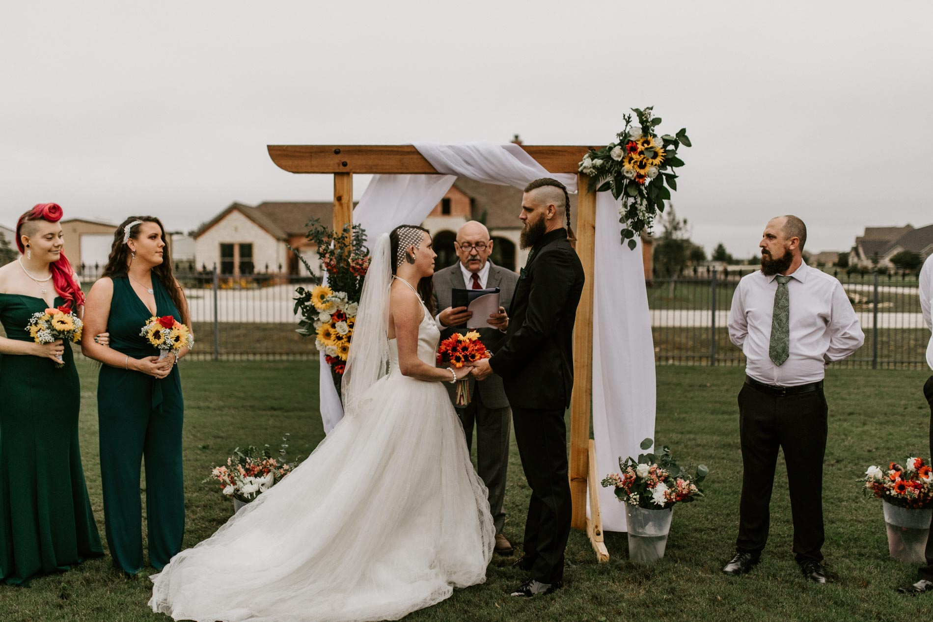alternative couple saying vows during their elopement