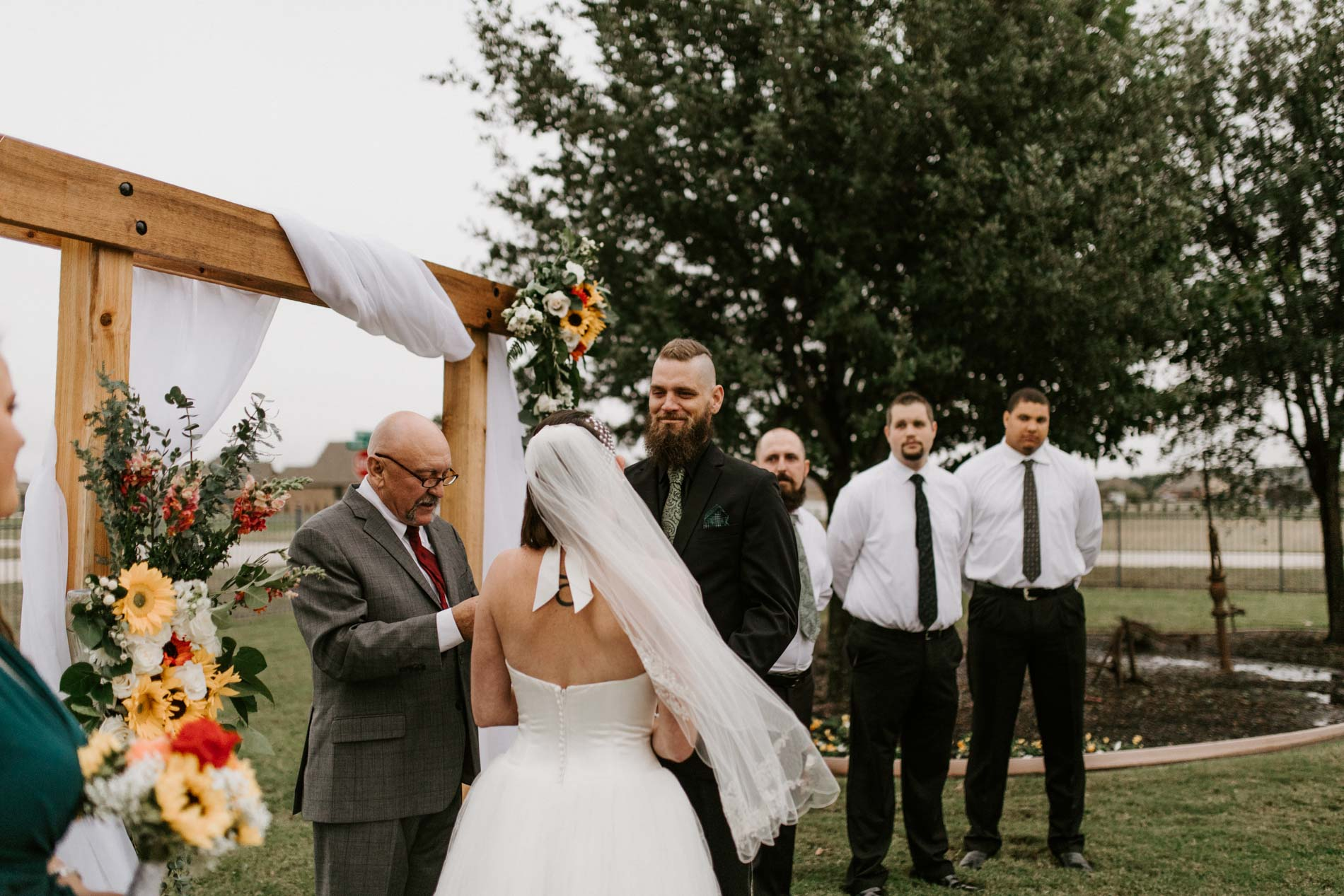 bride and groom standing at wedding ceremony