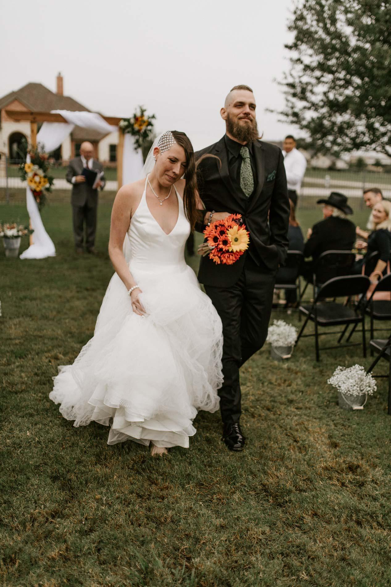 bride and groom leaving wedding reception