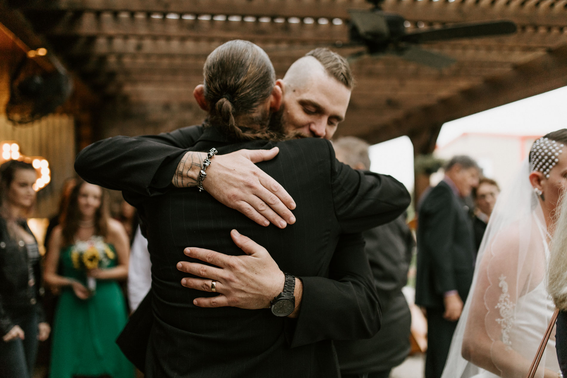 groom hugging father in law