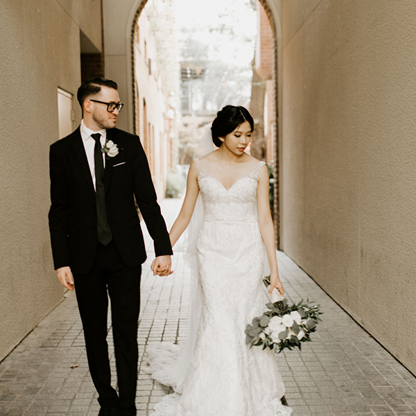 married couple walking in hallway after wedding ceremony during their wedding day timeline
