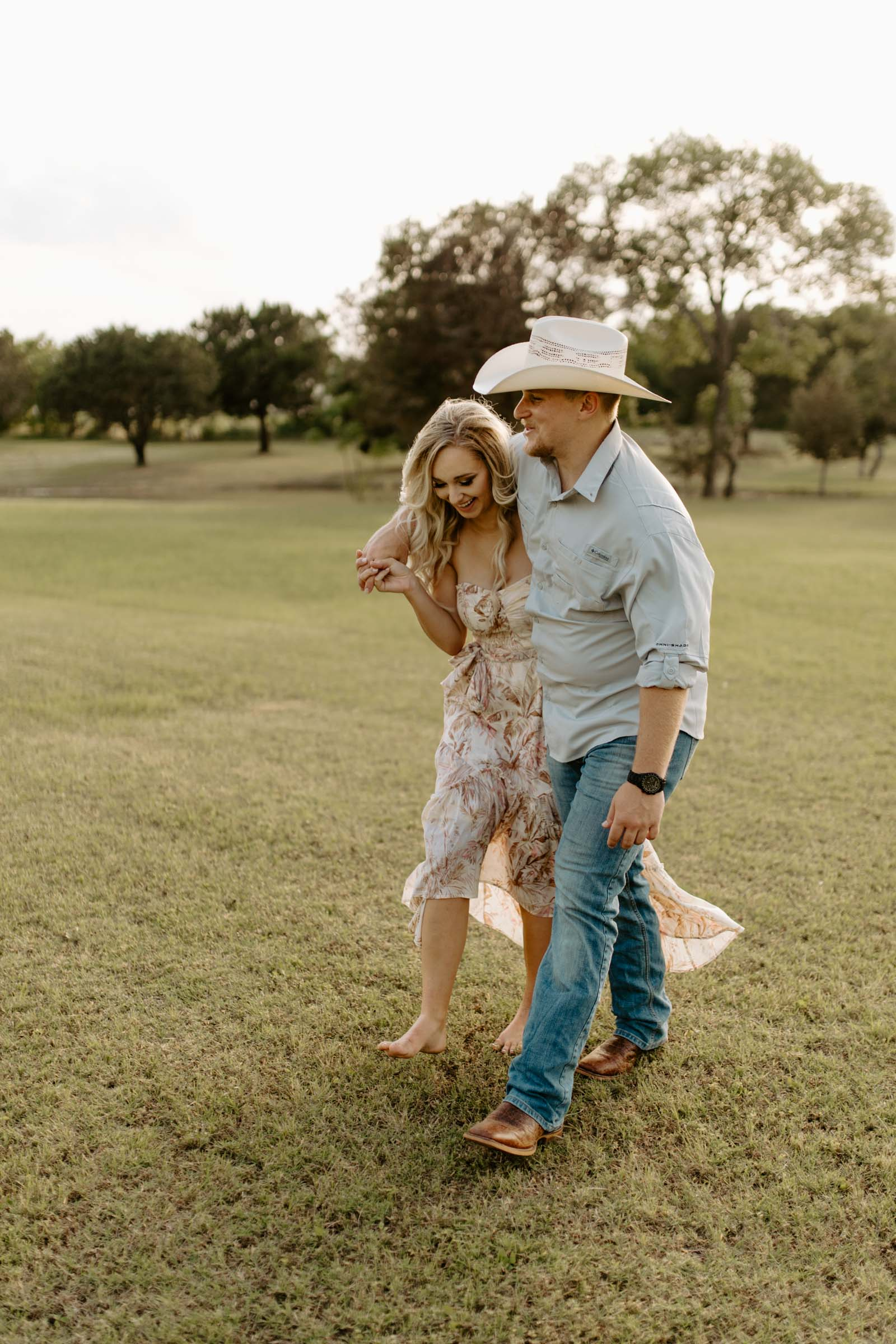 Couple walking in a field in Fort Worth
