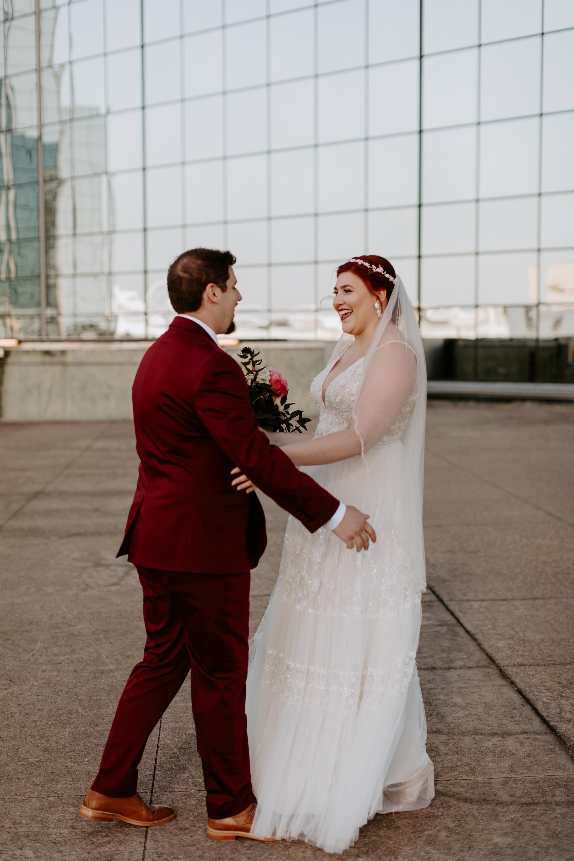 Bride and groom first look rooftop
