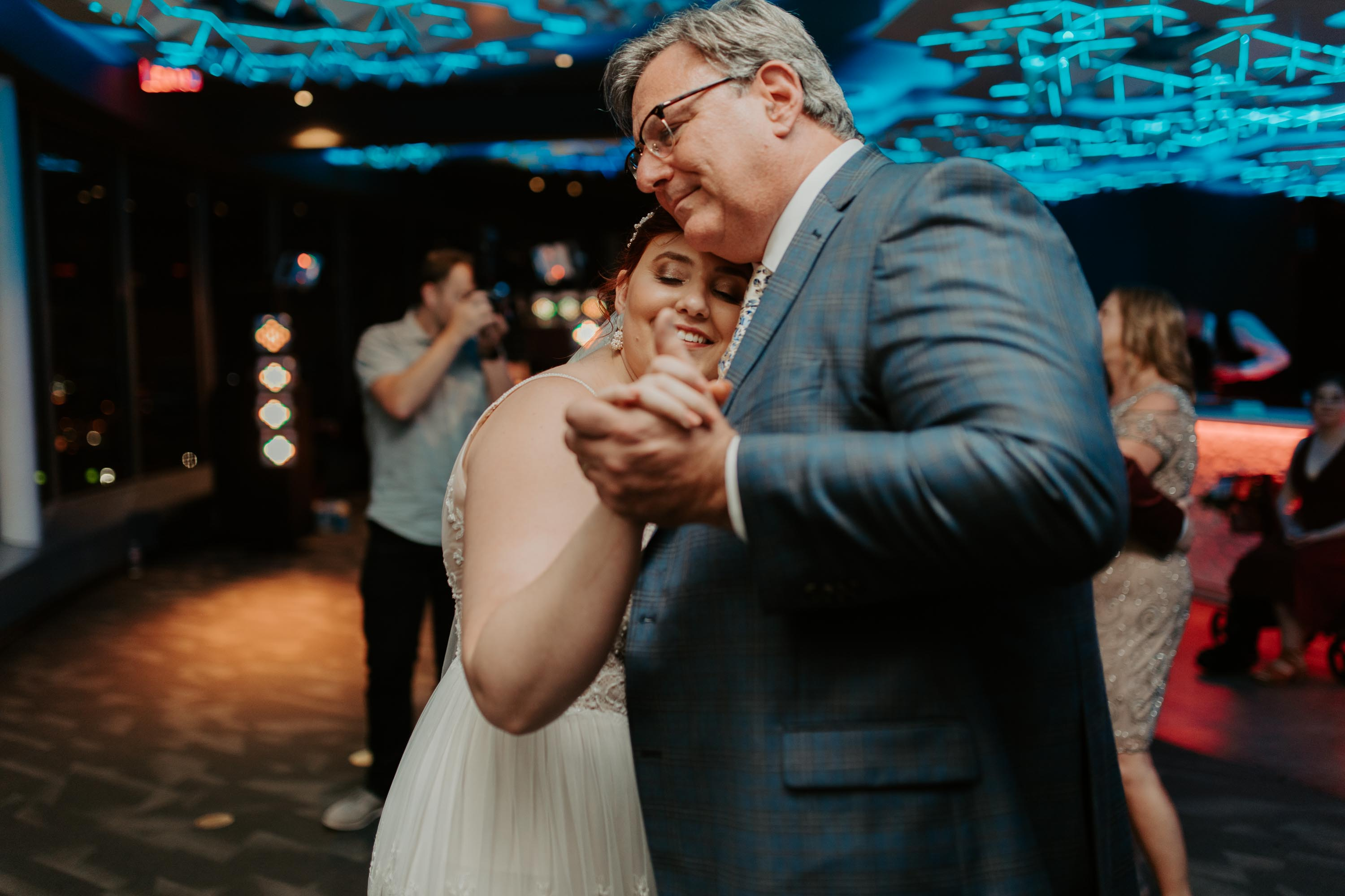 Bride dances with her father as a Dallas Texas tradition on wedding day