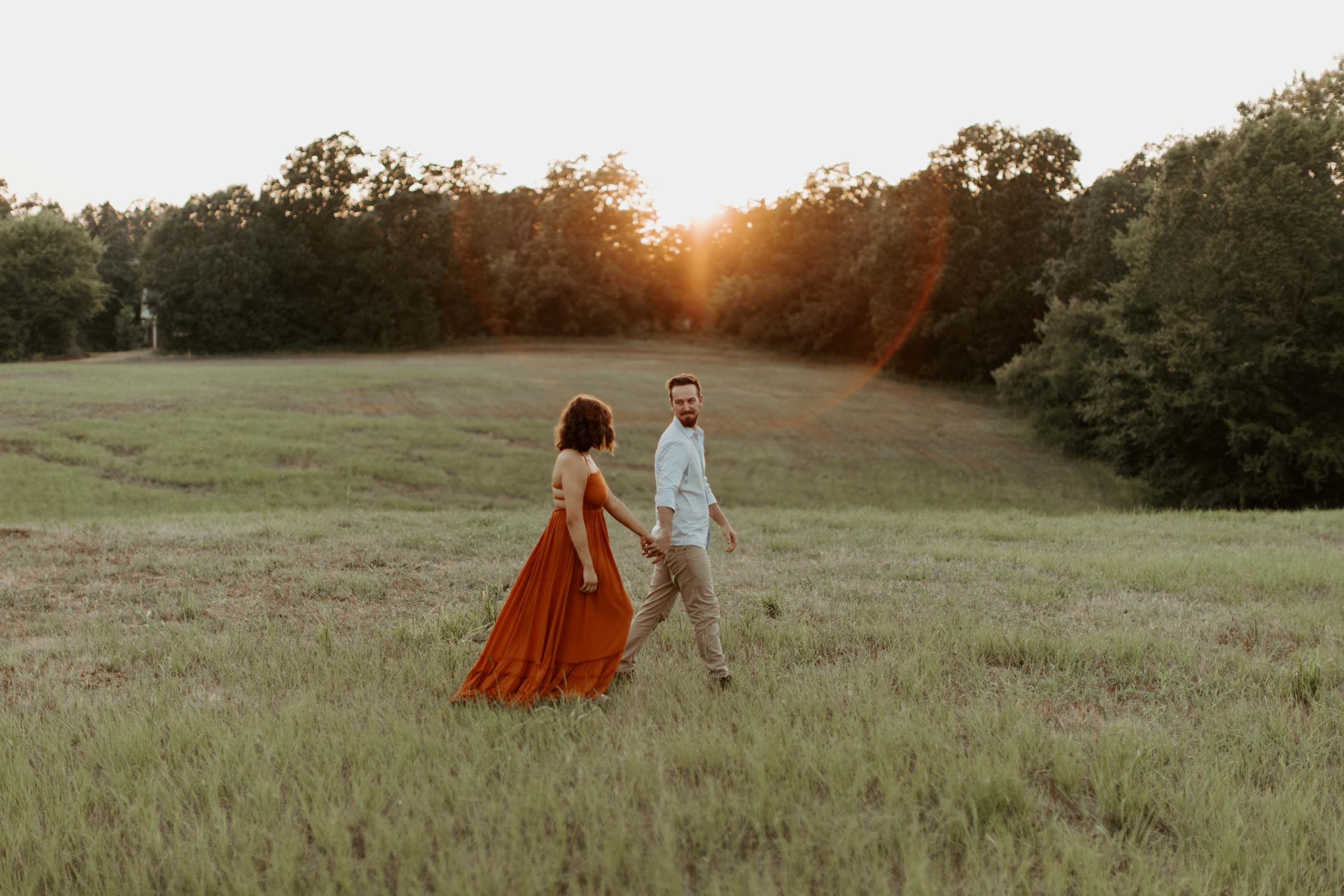 couple walking engagement photo prompt