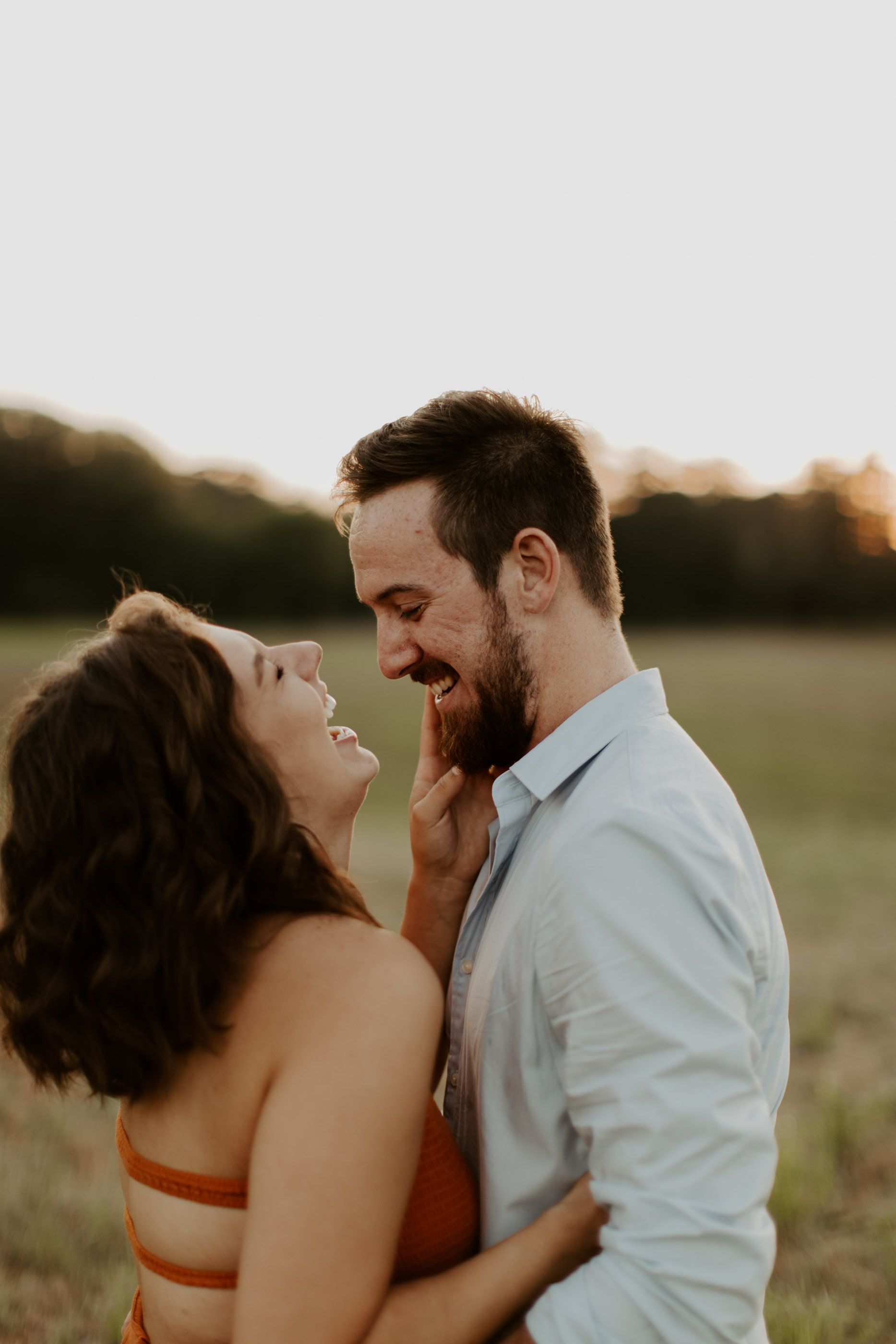 engagement photo of couple laughing