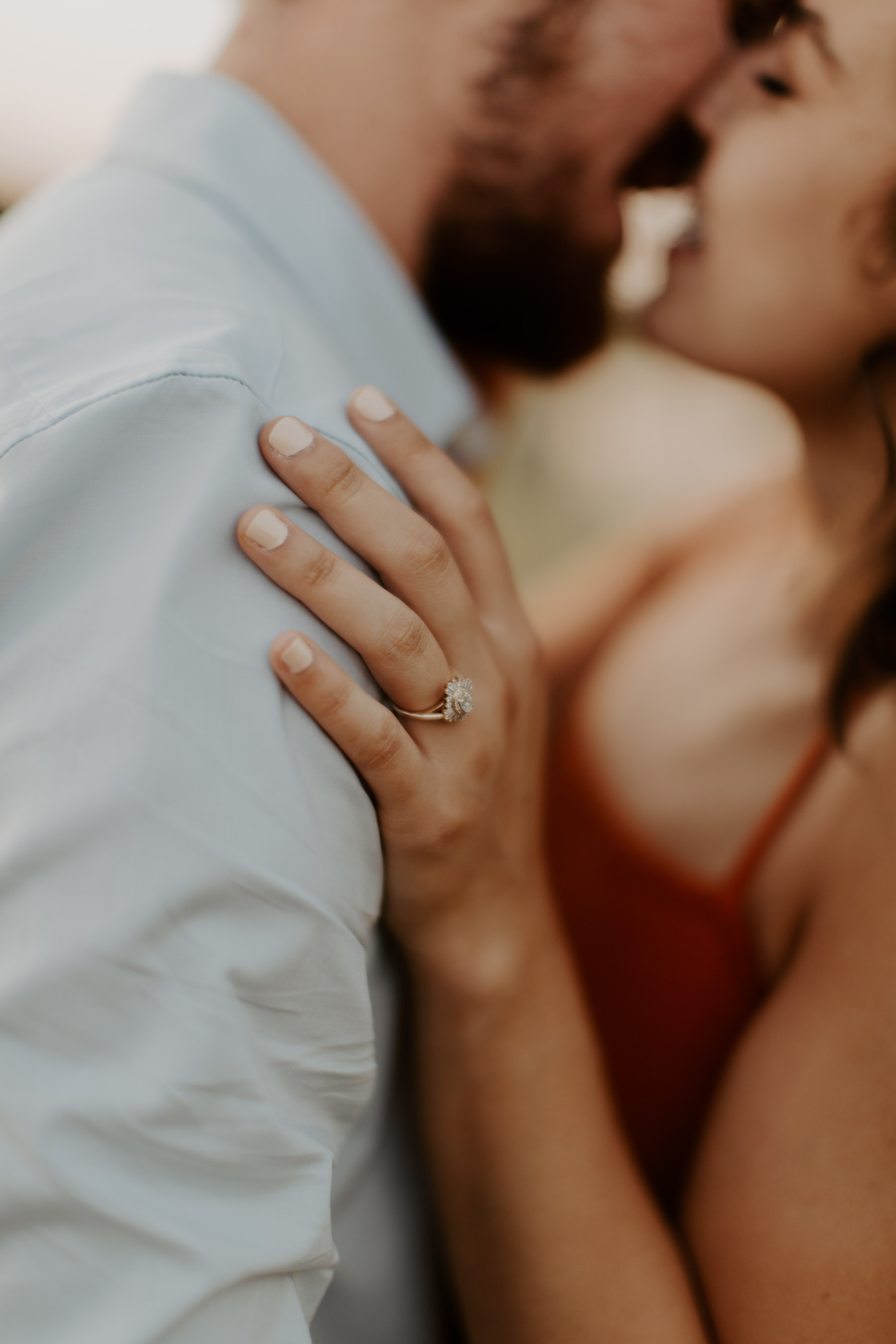 image of wedding ring and couple kissing