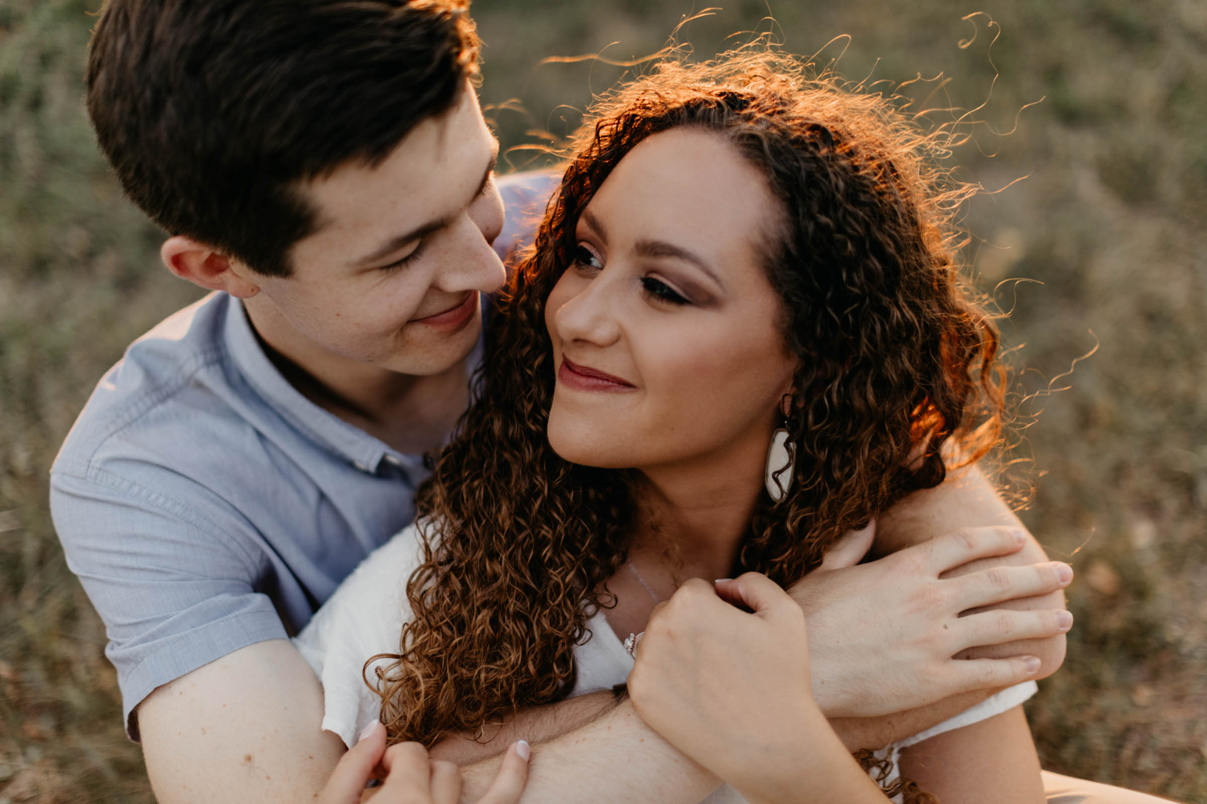Couple cuddling in Dallas texas for lakeside engagement session