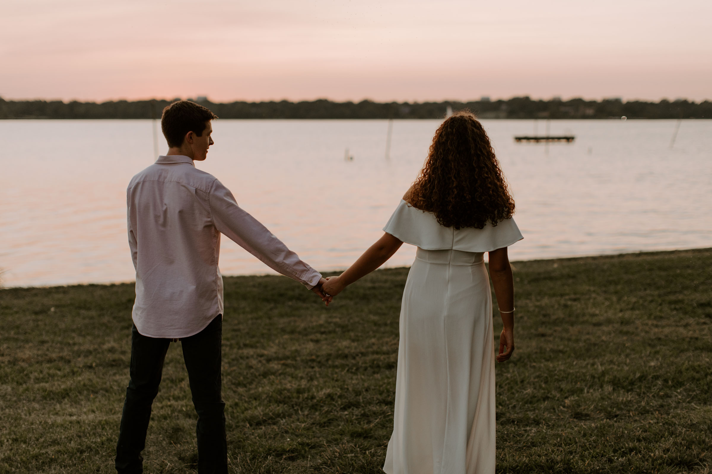 Romantic couple taking engagement photos by the lake