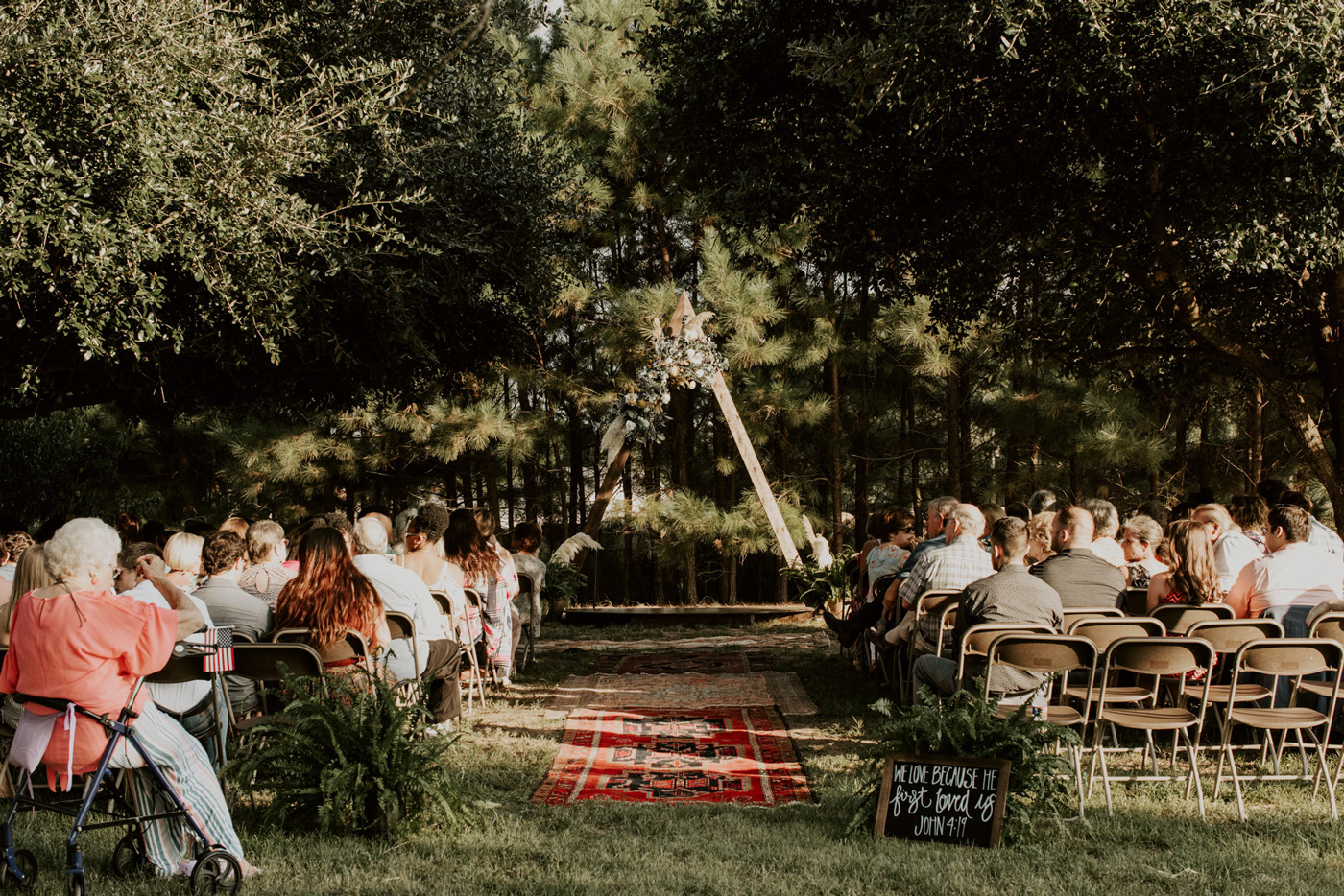 Bohemian wedding decor at backyard wedding ceremony
