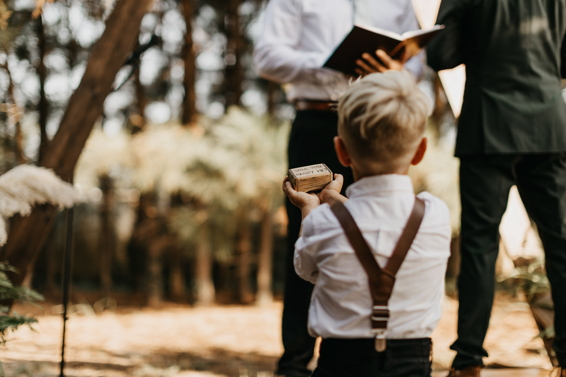 Adorable ring bearer during wedding ceremony