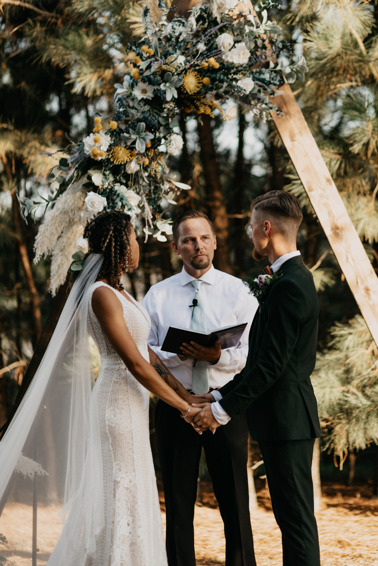Bride and groom standing at altar on wedding day