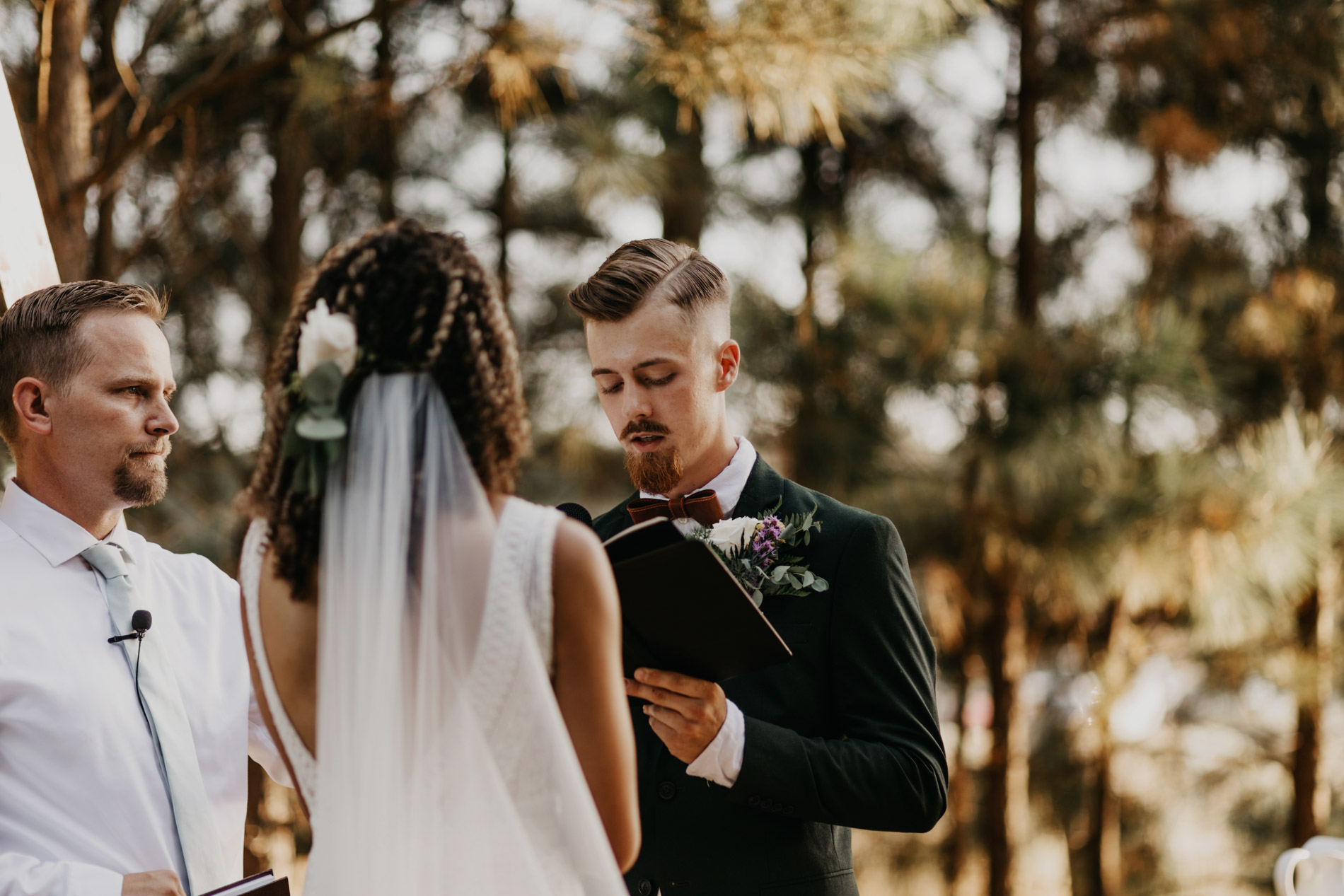 Groom readying hand written wedding vows