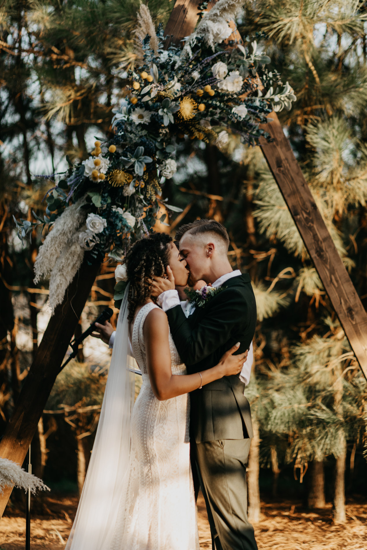 Bride and groom kiss for the first time on their wedding day