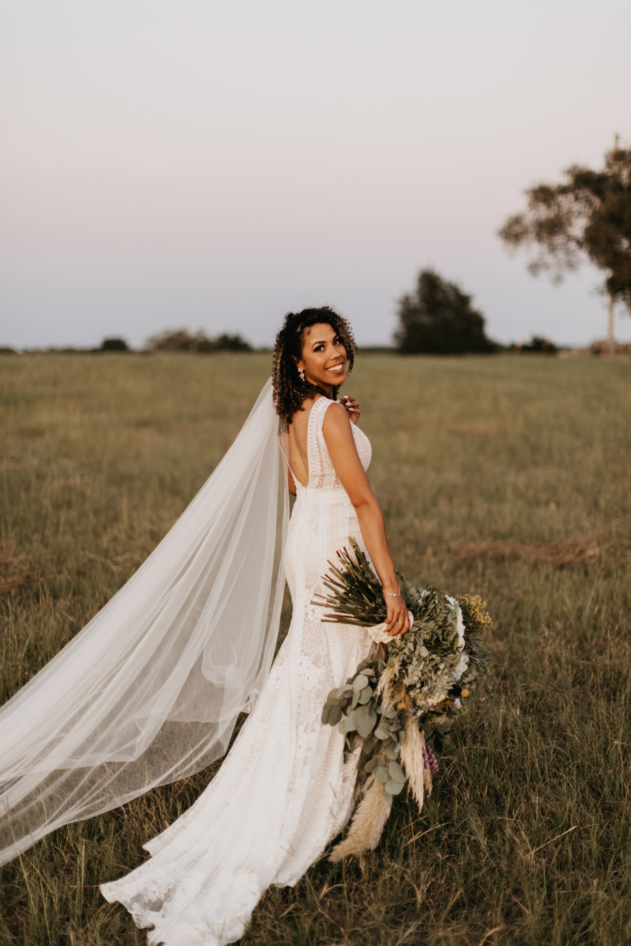 Bohemian bride posing on her wedding day in east texas