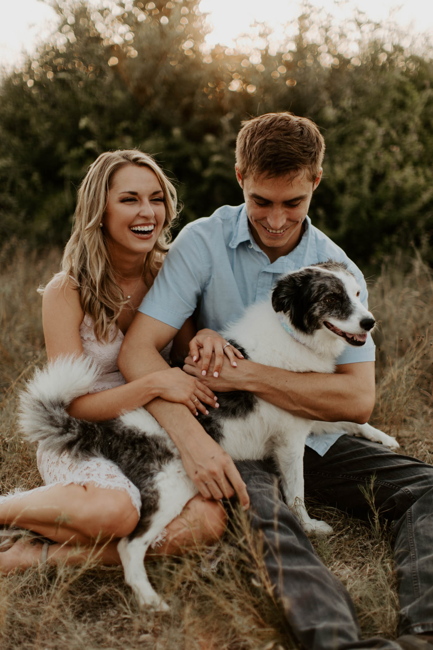 cute couple laughing with their pup