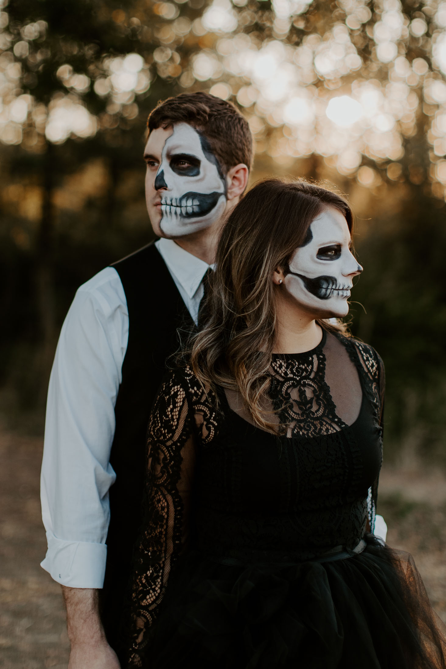 spooky couple looking in two different directions at sunset in Fort Worth