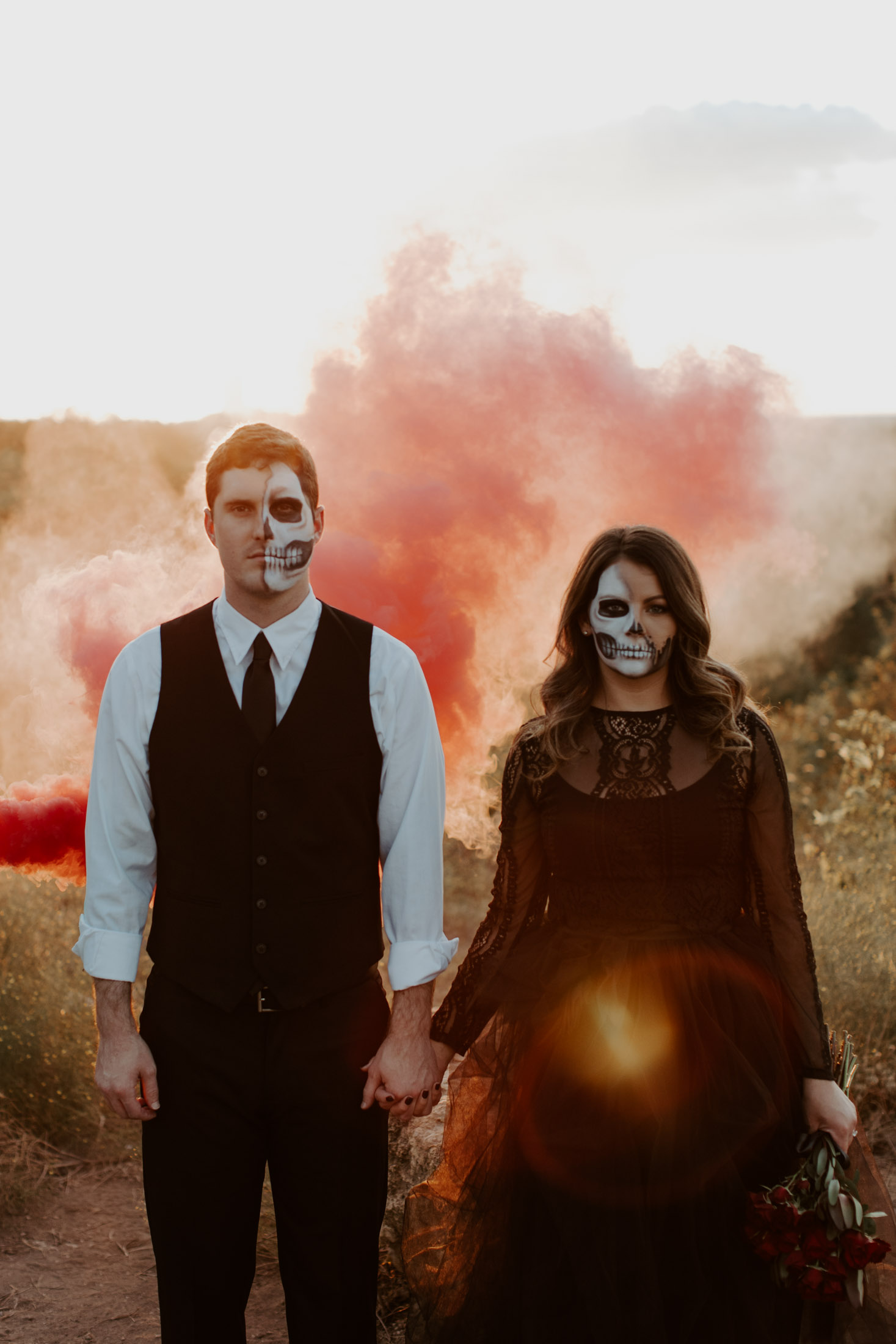colorful red smoke bomb in Fort Worth for a halloween couples session