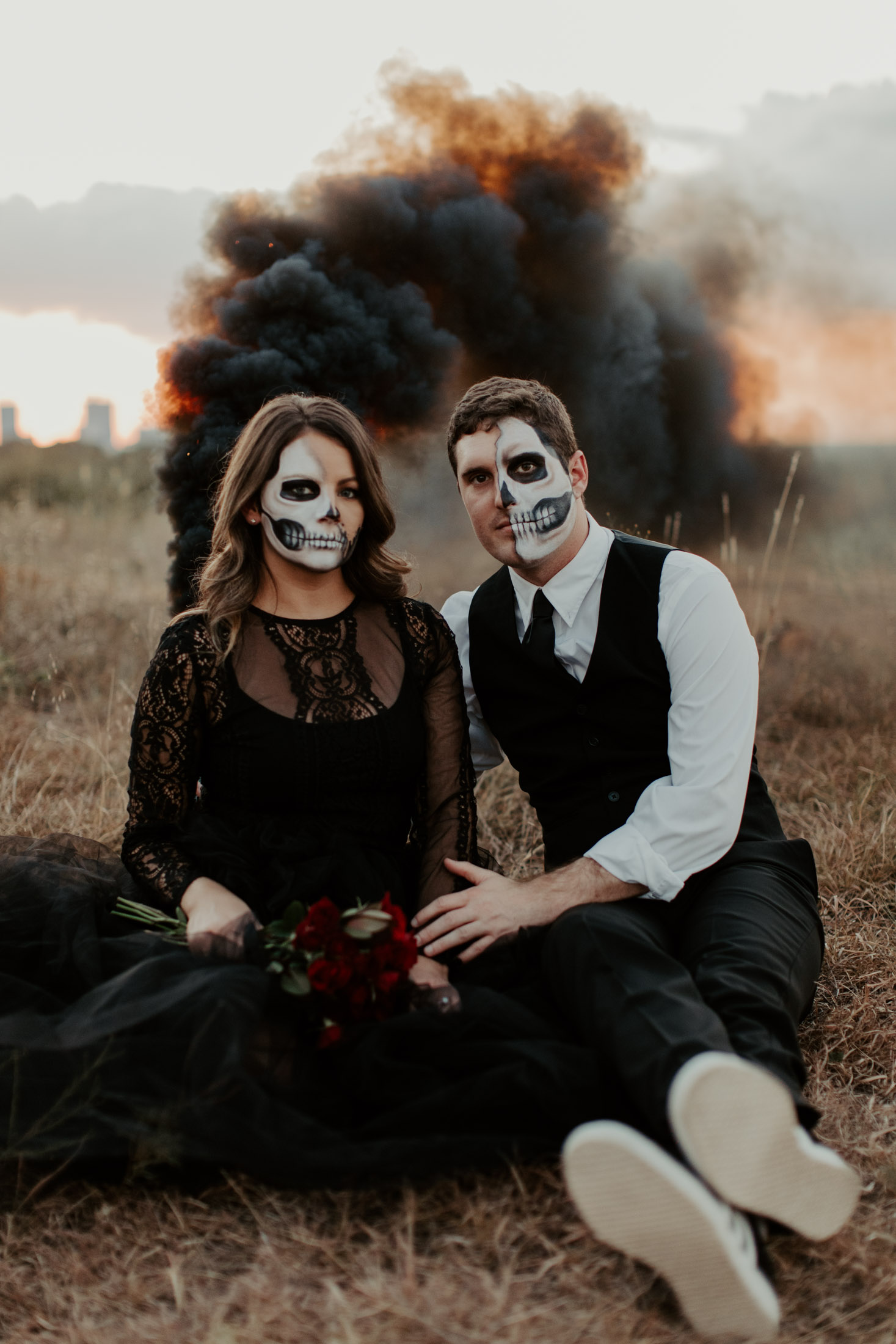 black smoke bomb with spooky couple sitting side by side