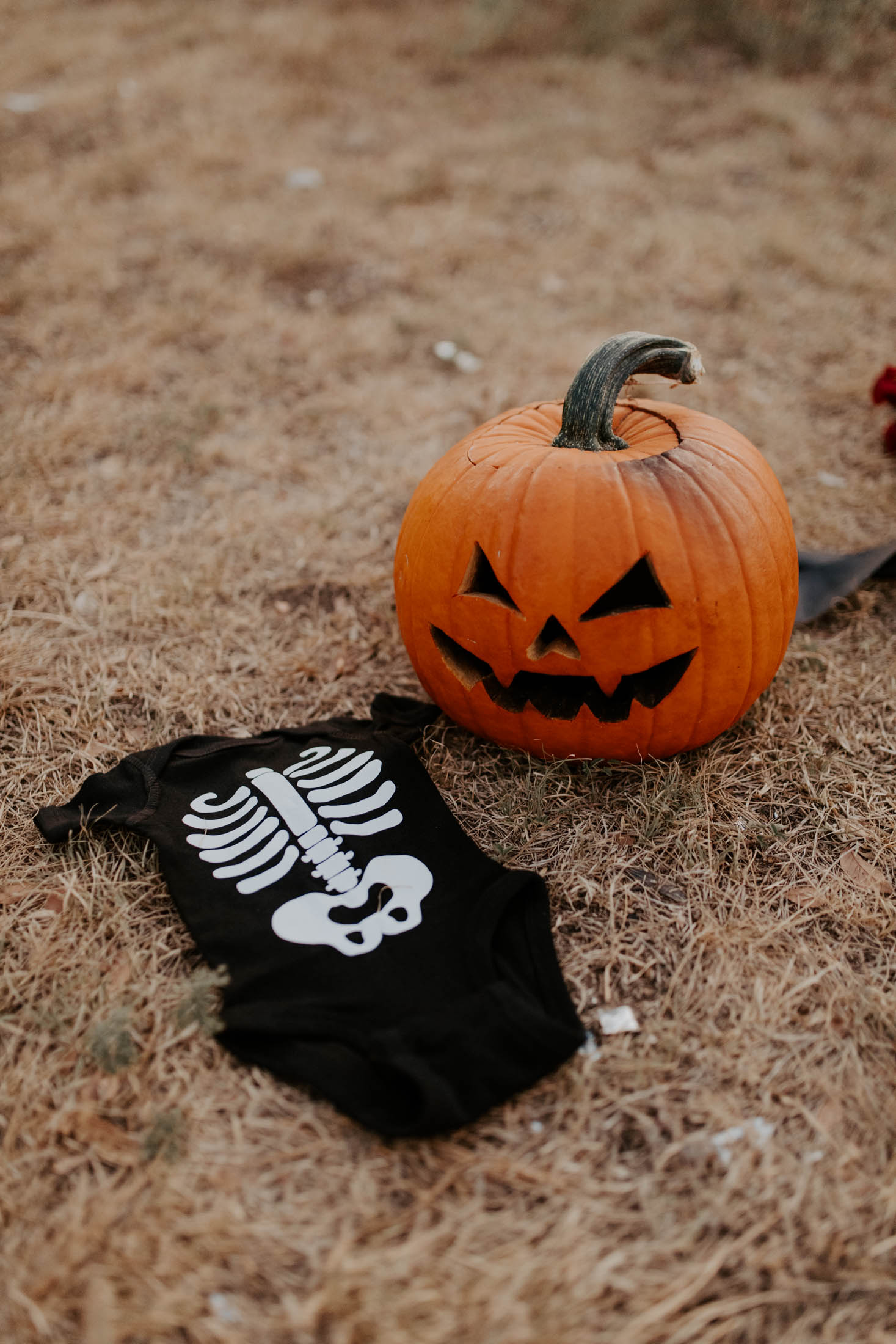 halloween themed baby announcement in Fort Worth with jack-o-lantern and skull makeup