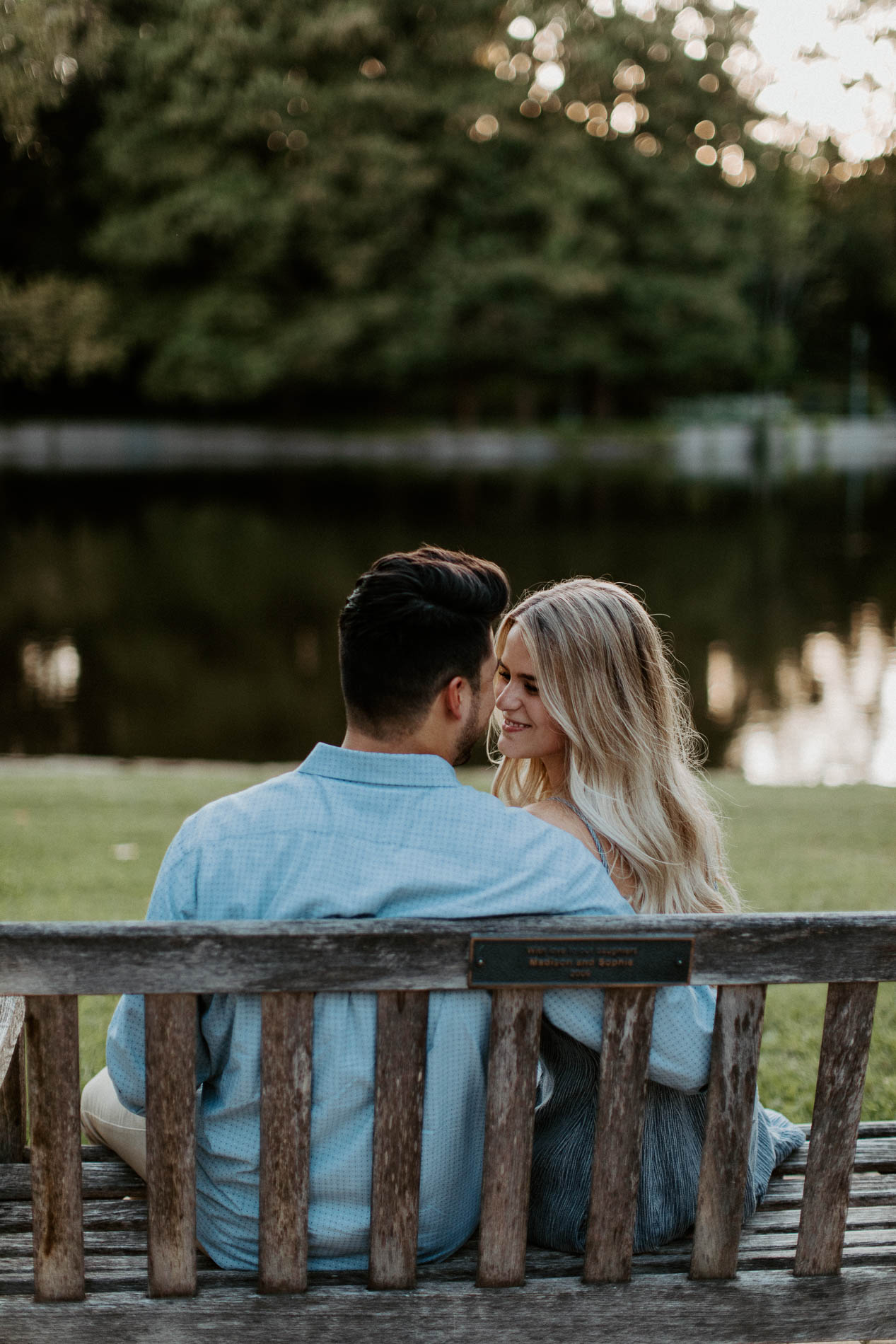 Couple sitting on a bench during engagement session in Fort Worth