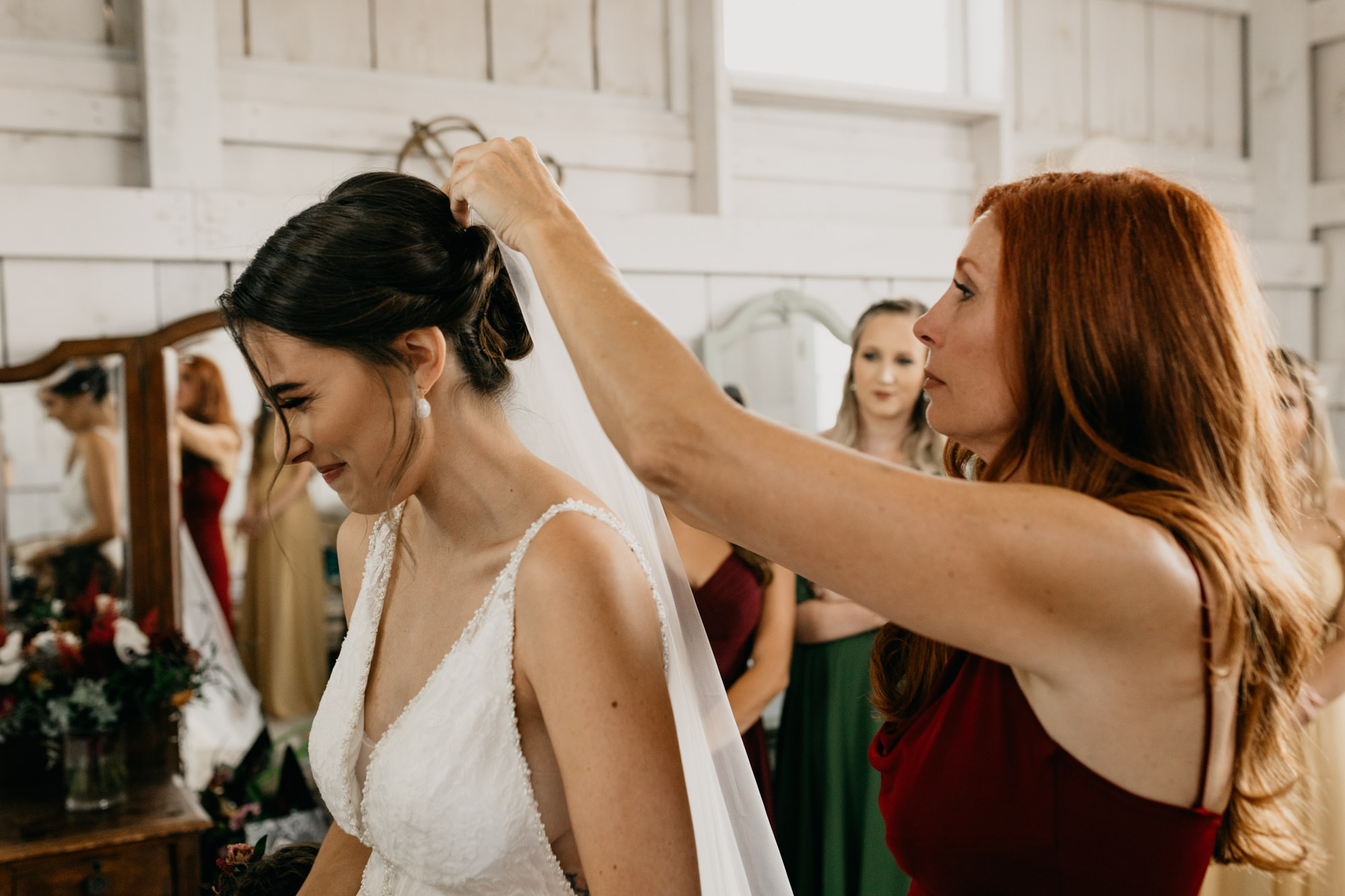 mom putting veil in brides hair