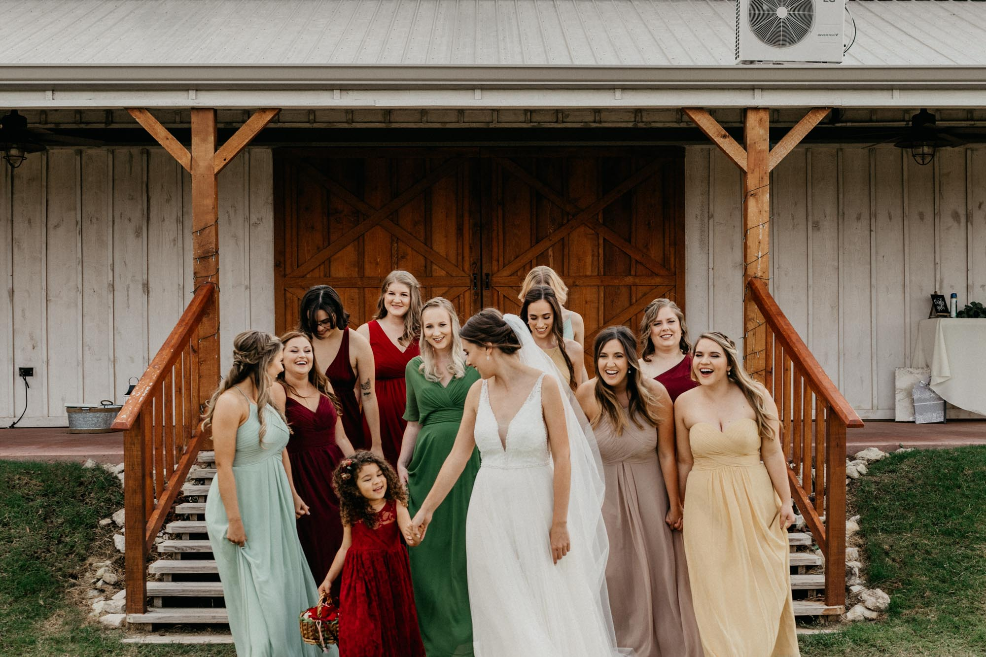 stunning bridal party walks down stairs