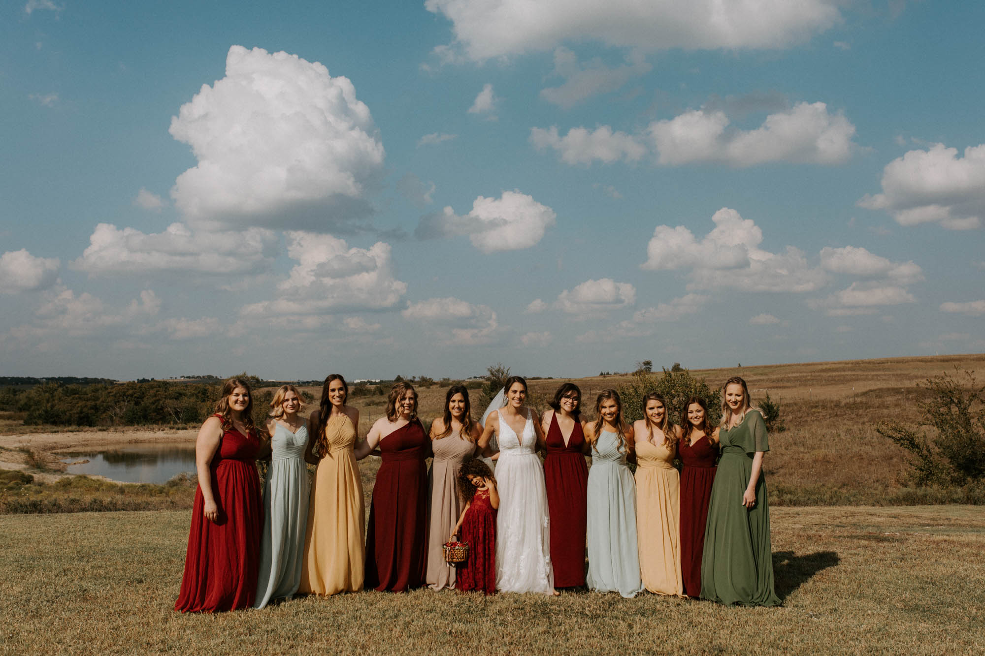 bridal party pictures in a field in north texas wedding