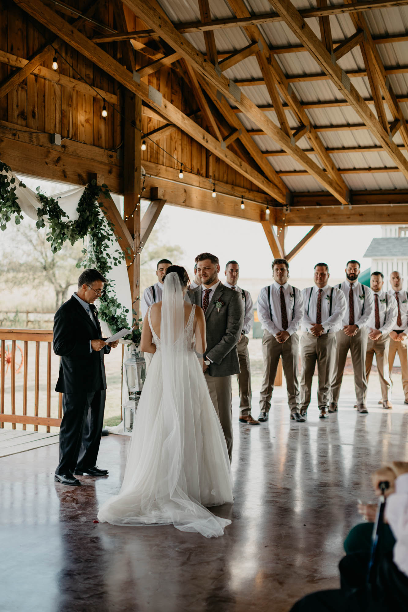 bride and groom standing at the alter together at a north texas wedding