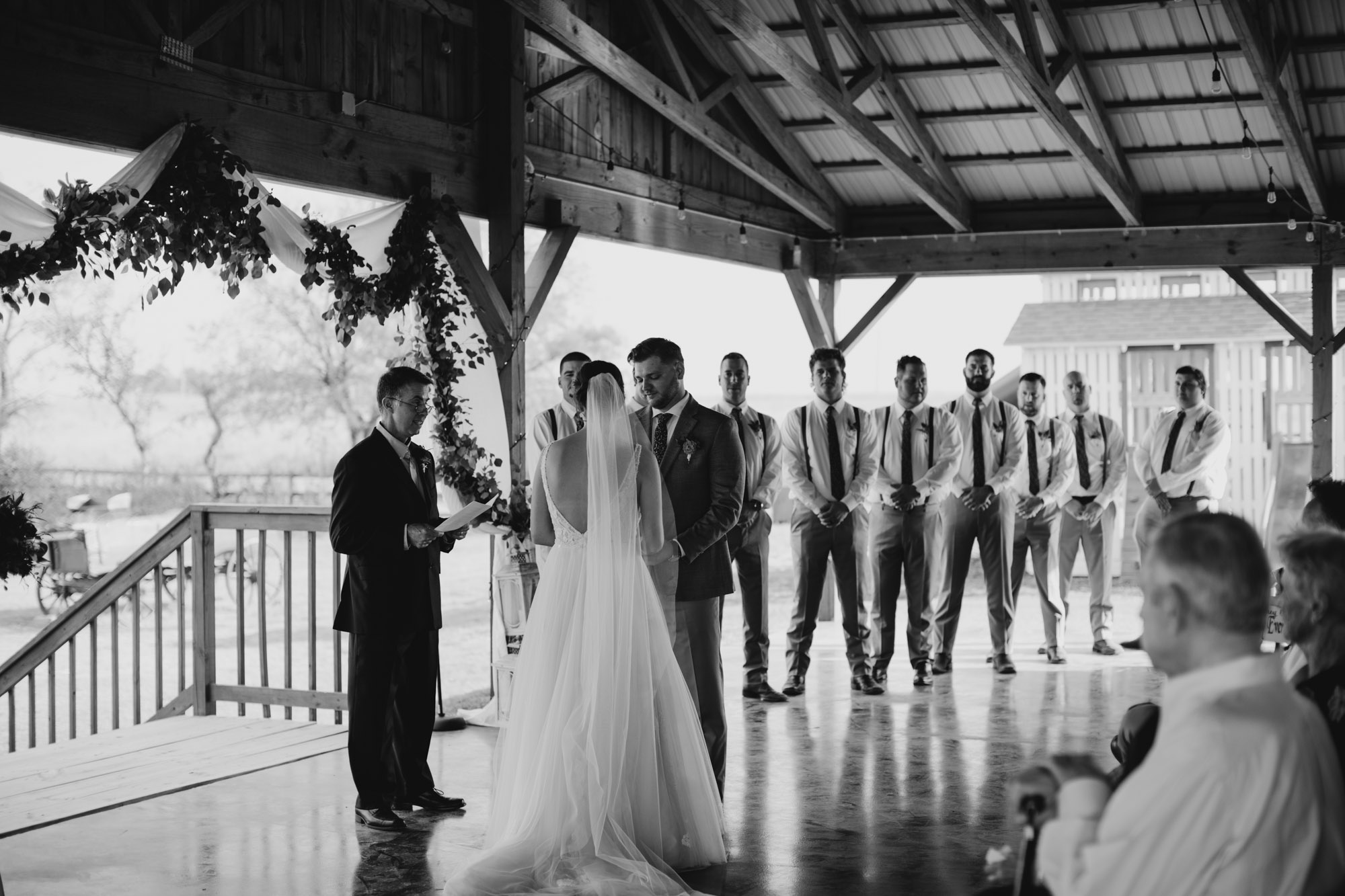 black and white photo of bride and groom standing at the alter together at a north texas wedding