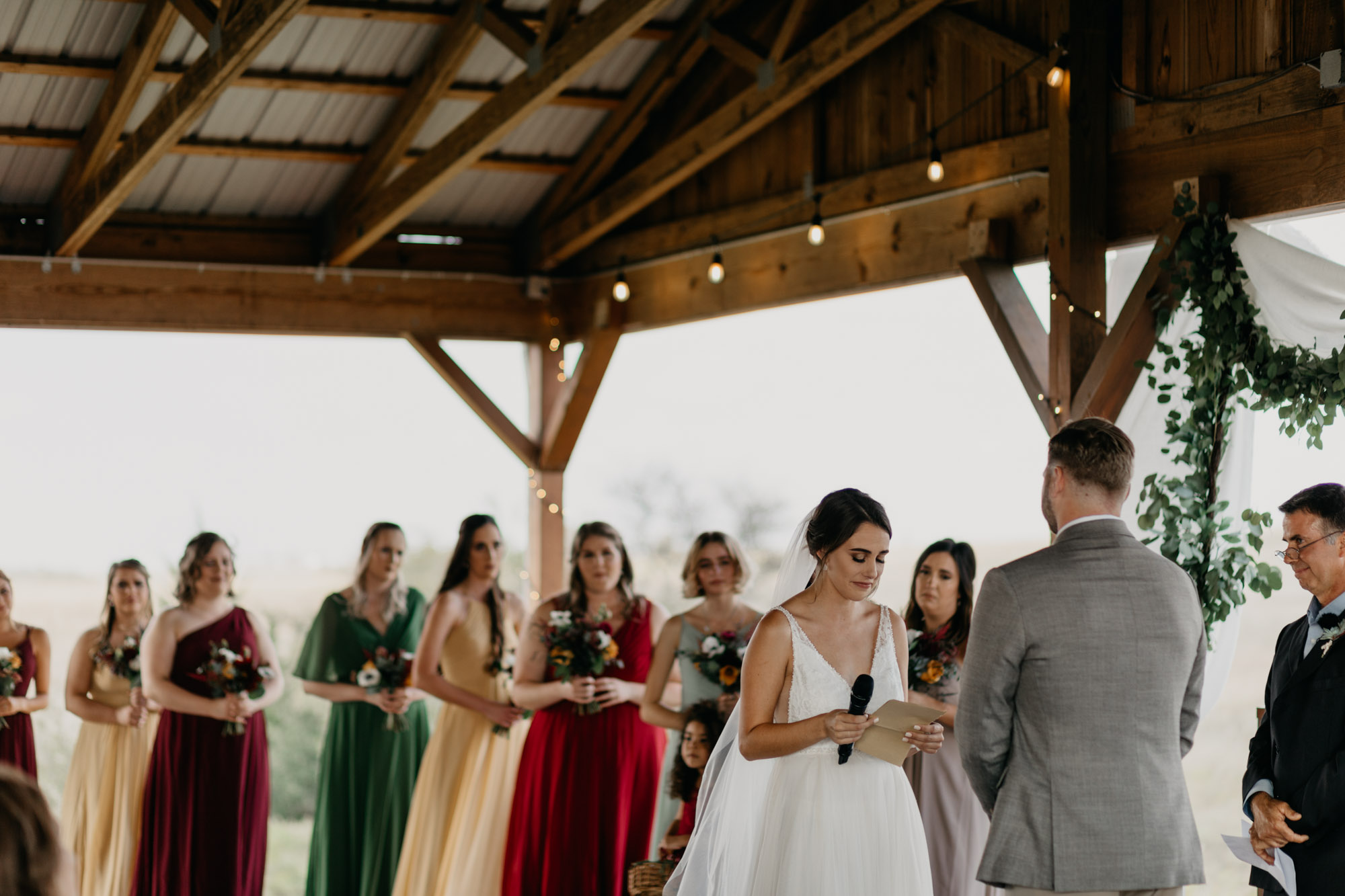 bride crying as she says her vows to her groom