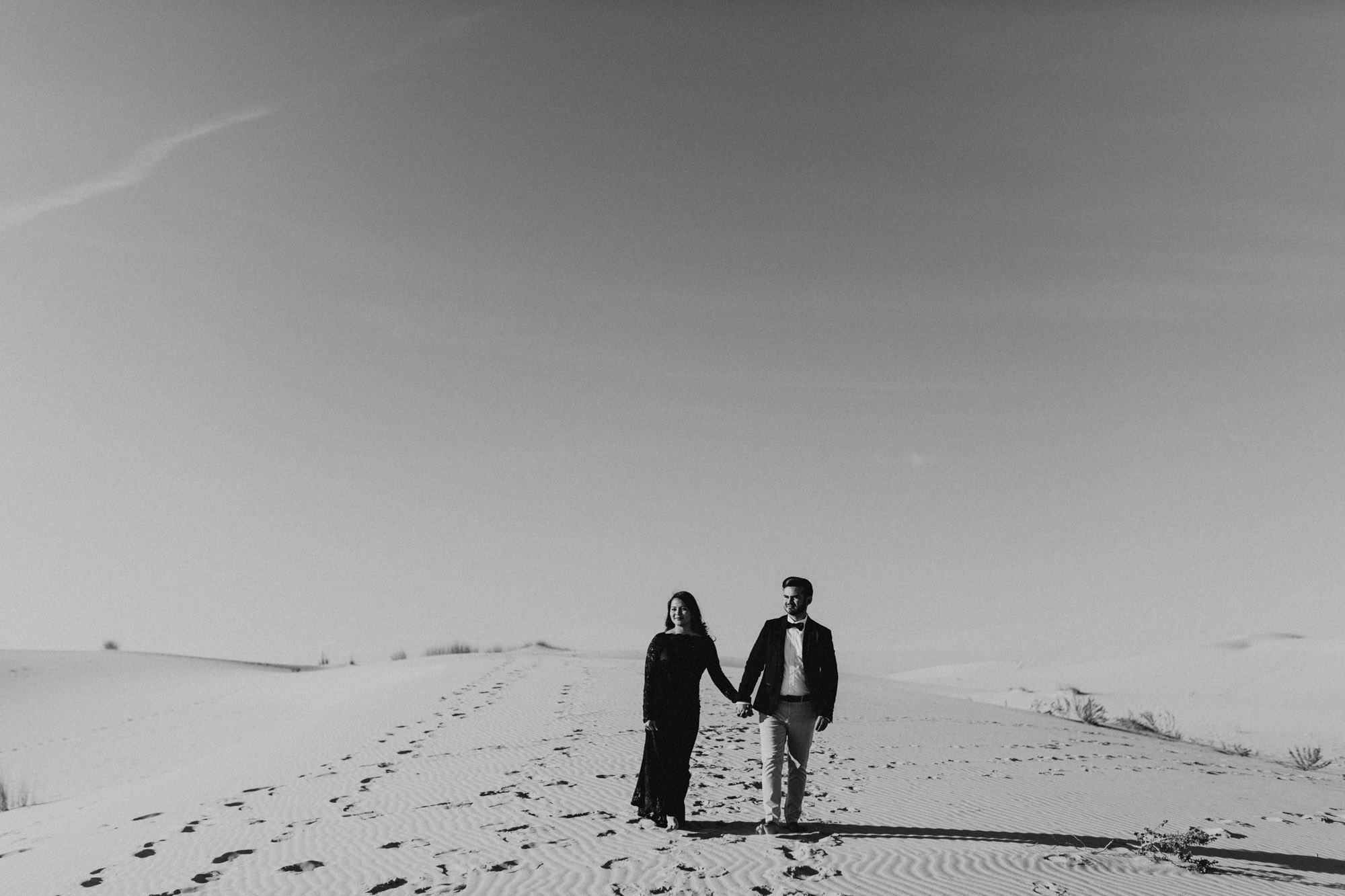Black and white photo of a couple at an engagement session at Monahans sand hills state park