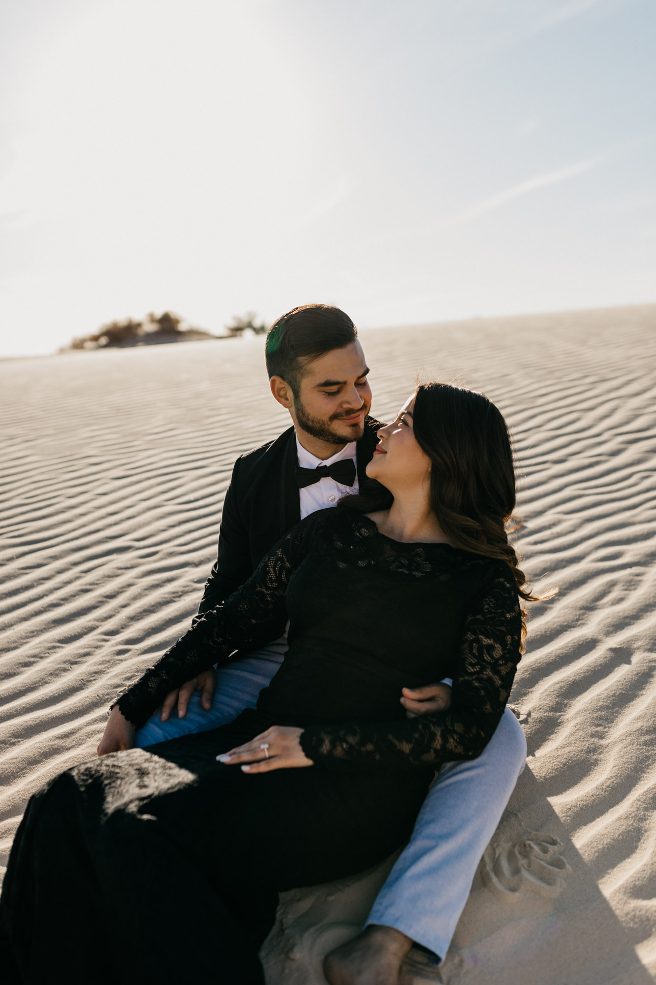 This adventurous couple loved rolling around in the sand hills during their romantic engagement session in west texas