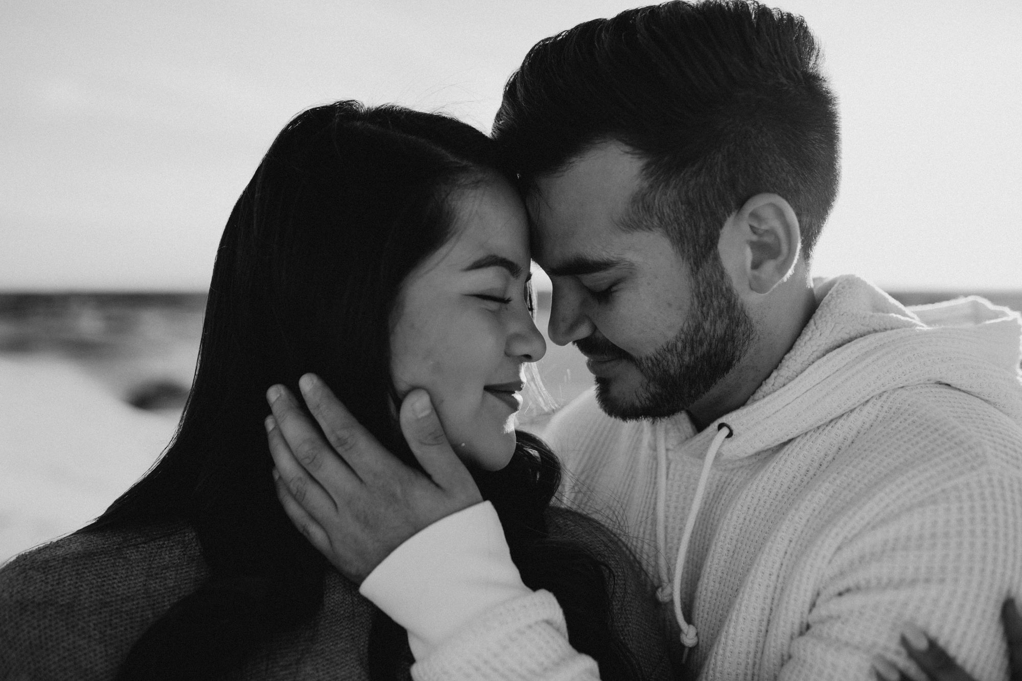 Black and white romantic photo of couple during their sand hills engagement session
