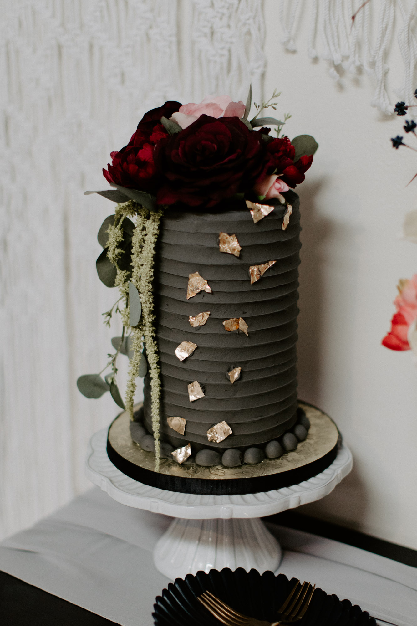 tasty looking black wedding cake at moody styled shoot