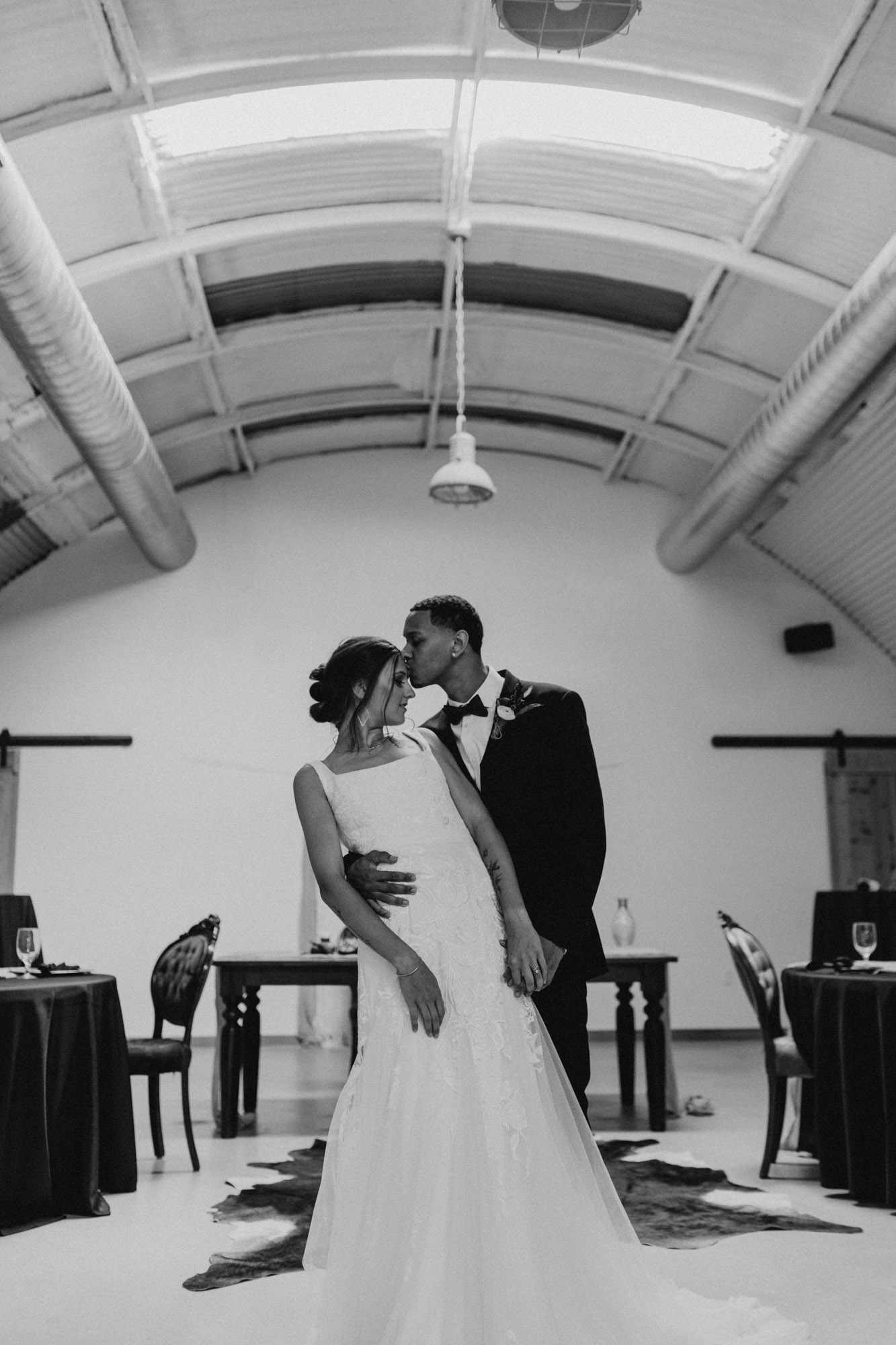 moody black and white traditional wedding photo