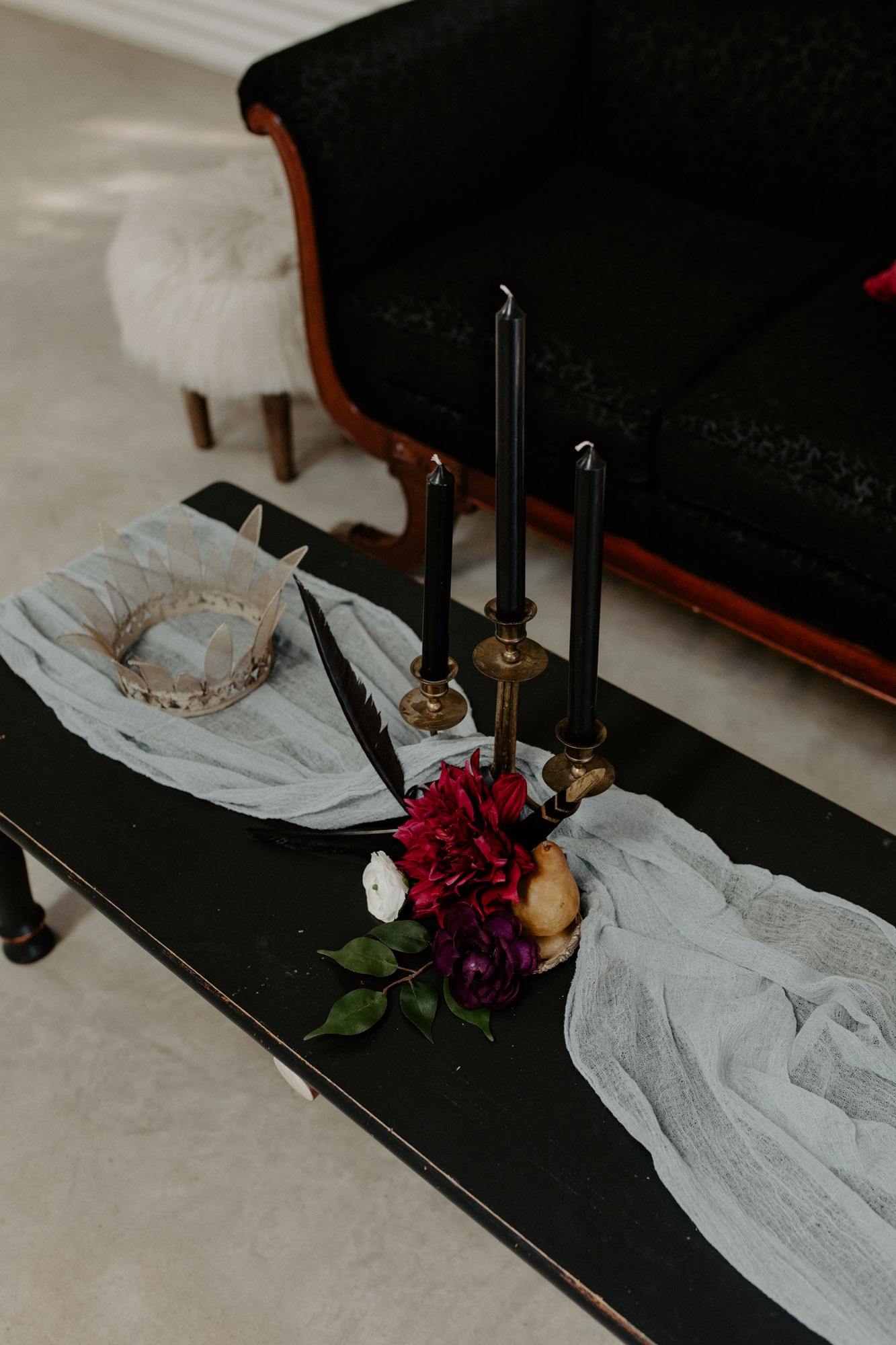 moody coffee table decor at wedding styled shoot