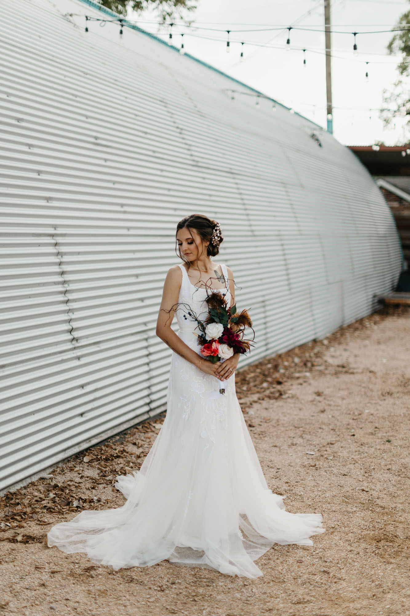 beautiful bride in trendy white wedding dress