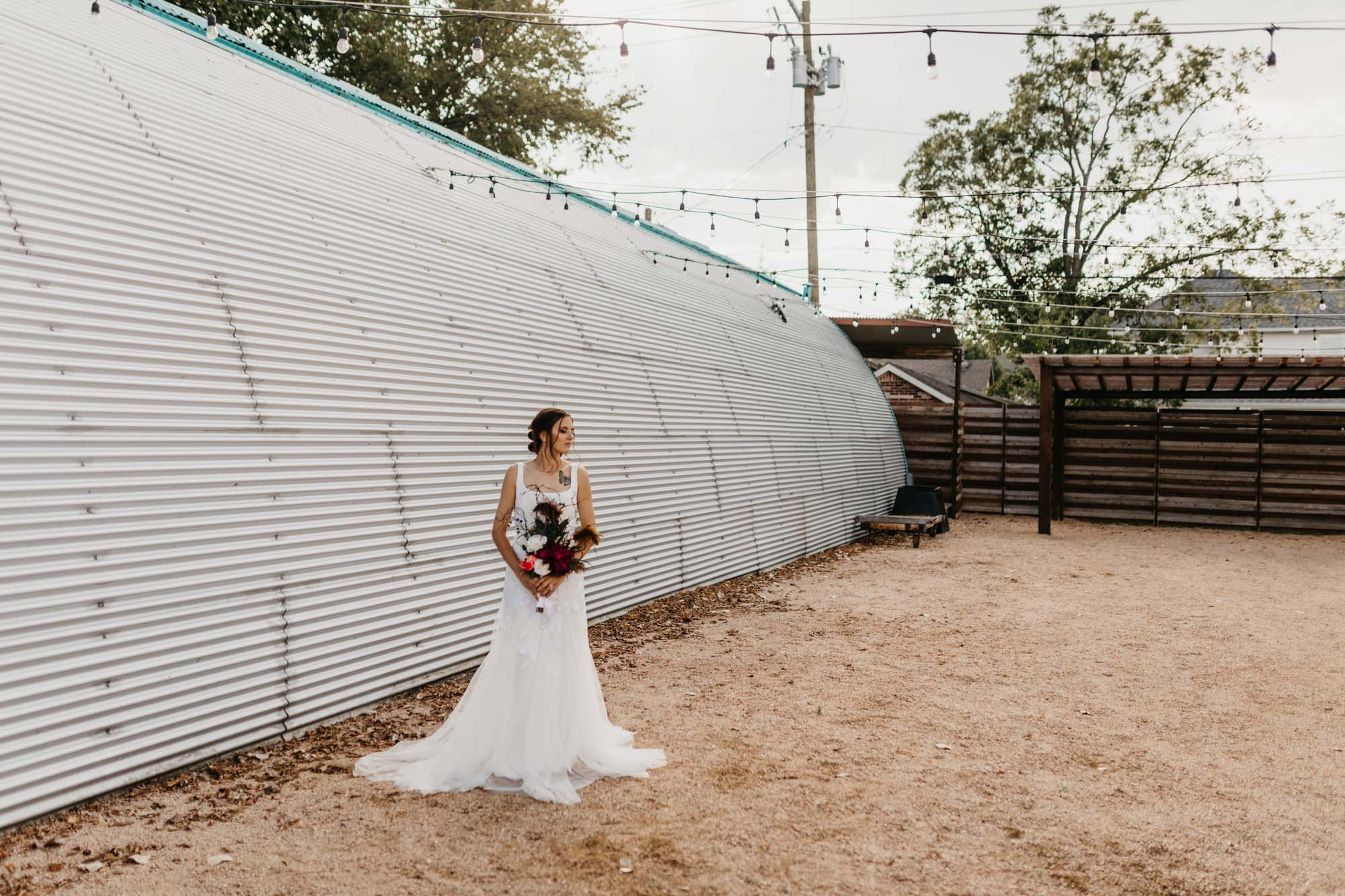 landscape shot of industrial venue and bride