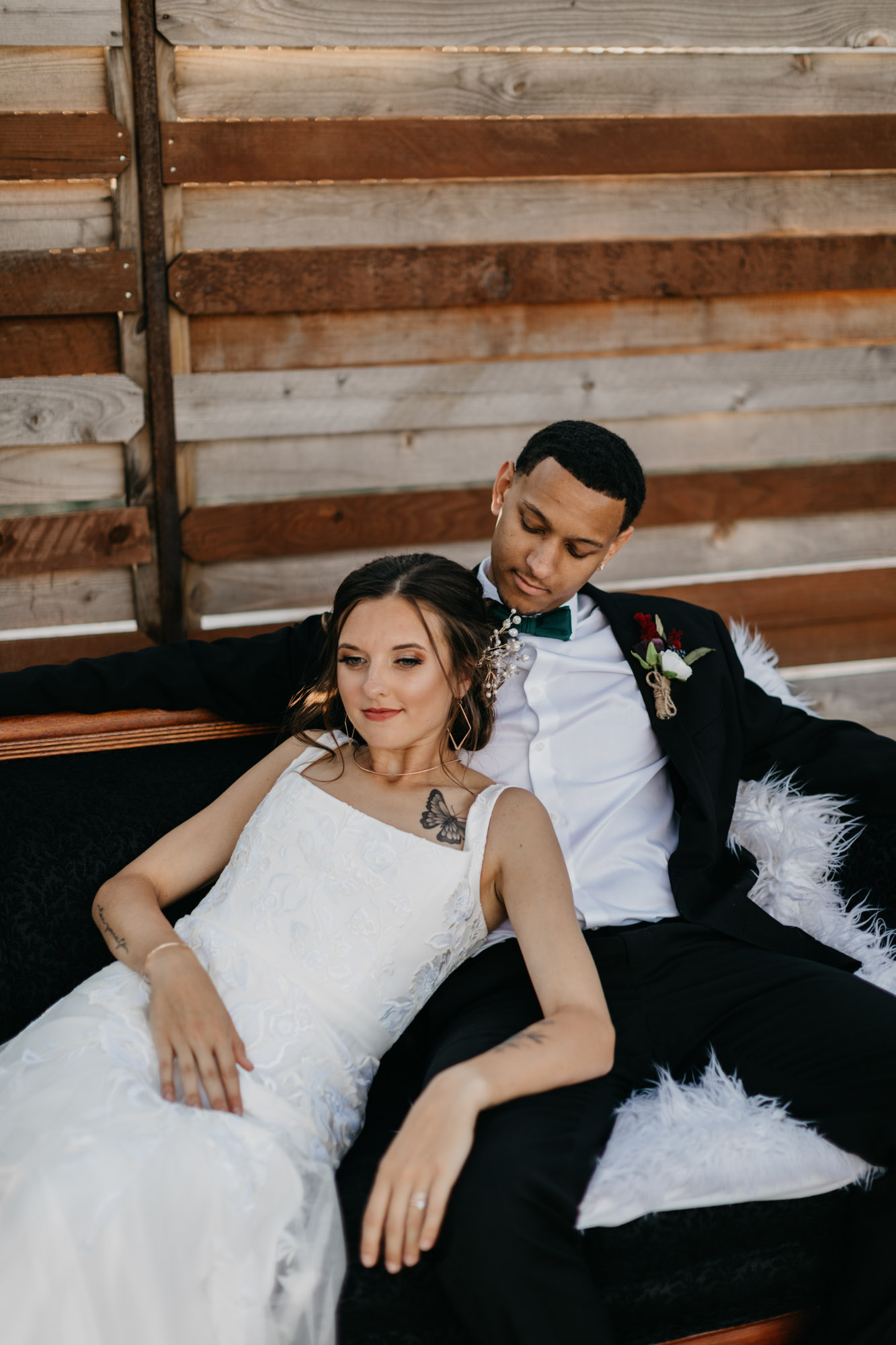 bride and groom lounging on wedding day
