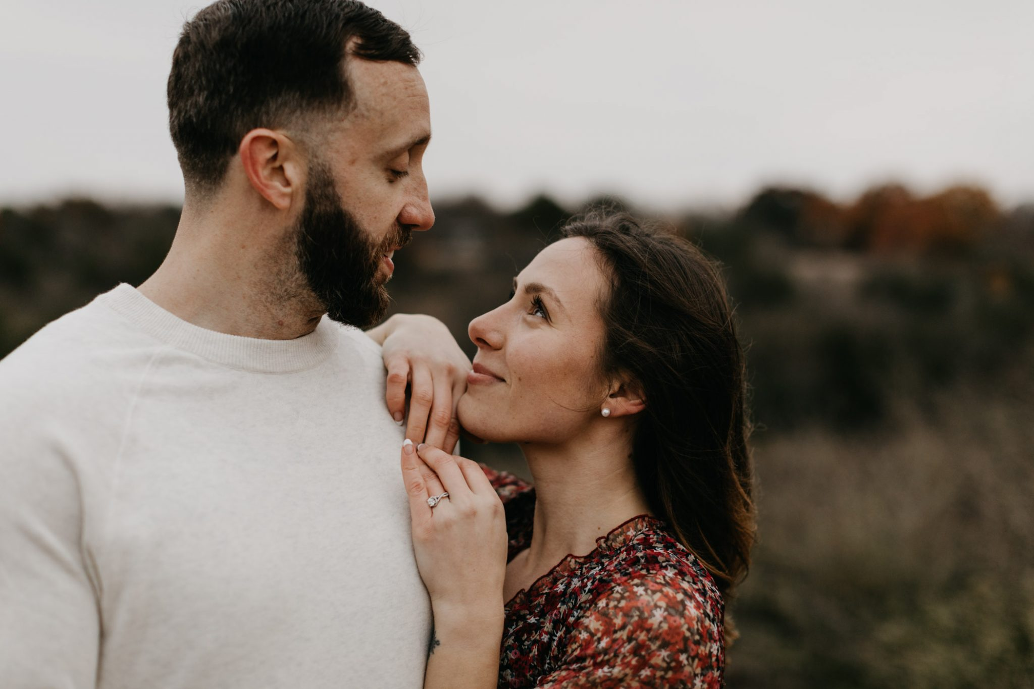 Girl longingly looking up to finance during engagement session in fort worth