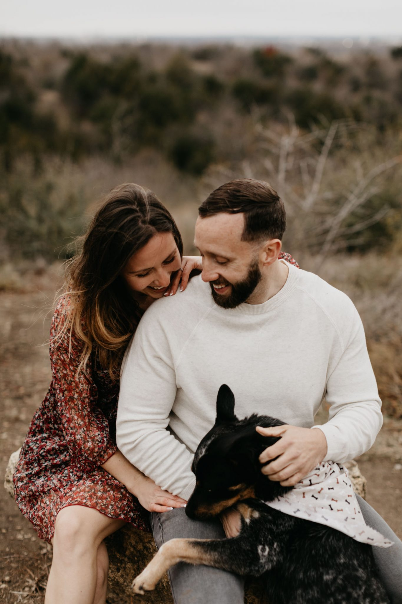 Cute couple playing with their dog during a couples photography session
