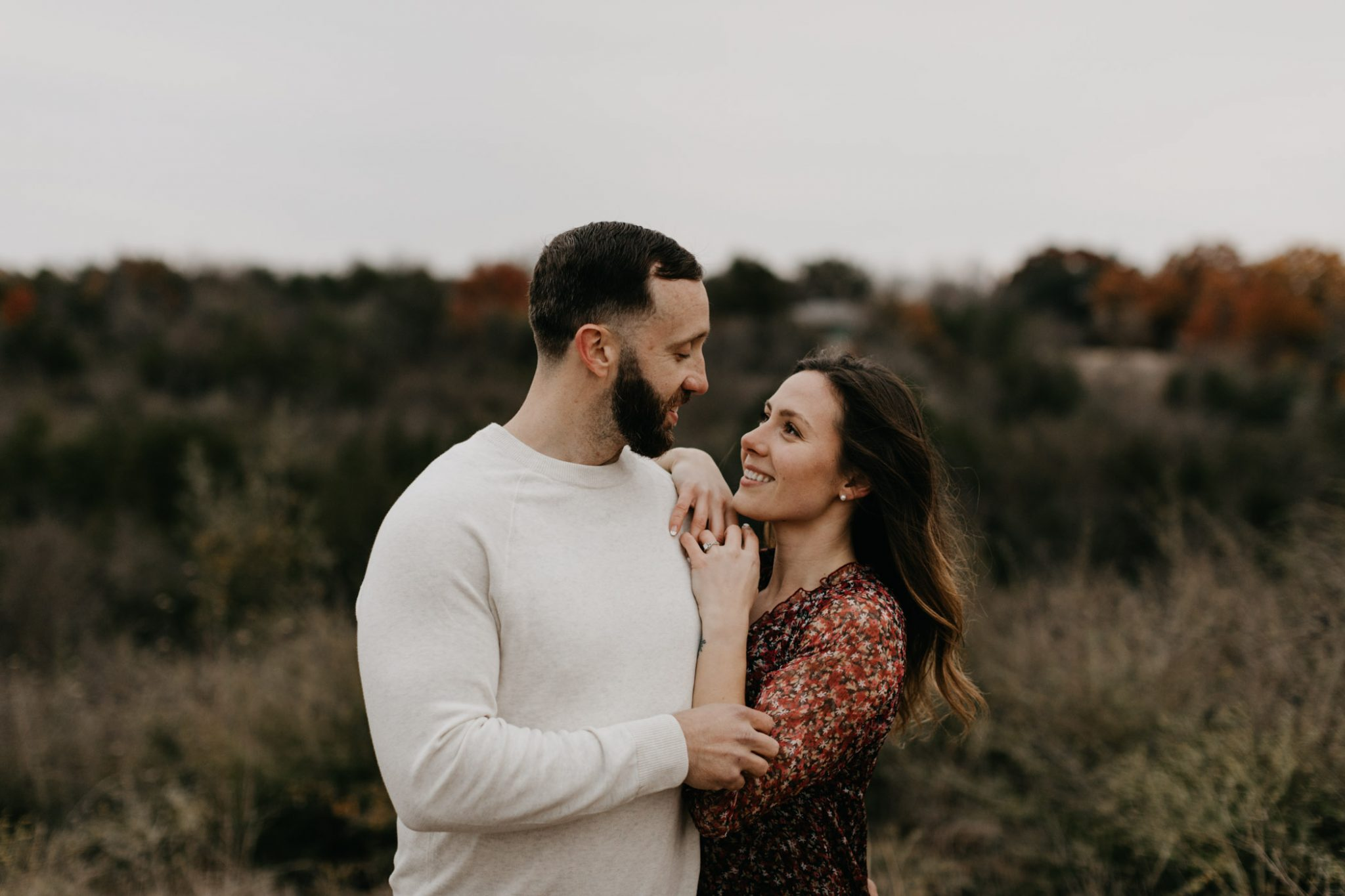 Romantic Couple flirting during winter engagement session