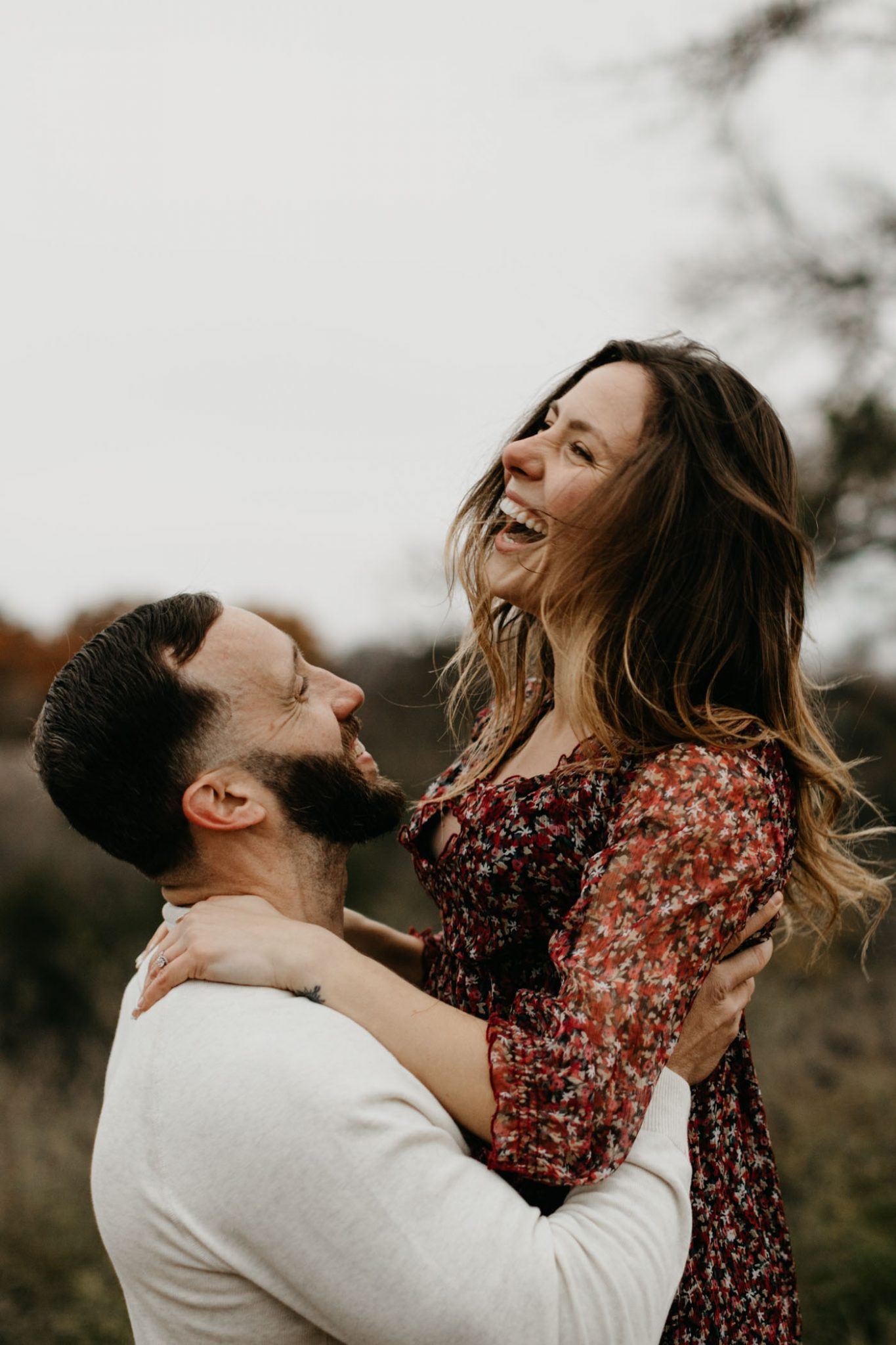 Adorable couple laughing and being playful during a romantic couples session in Fort Worth