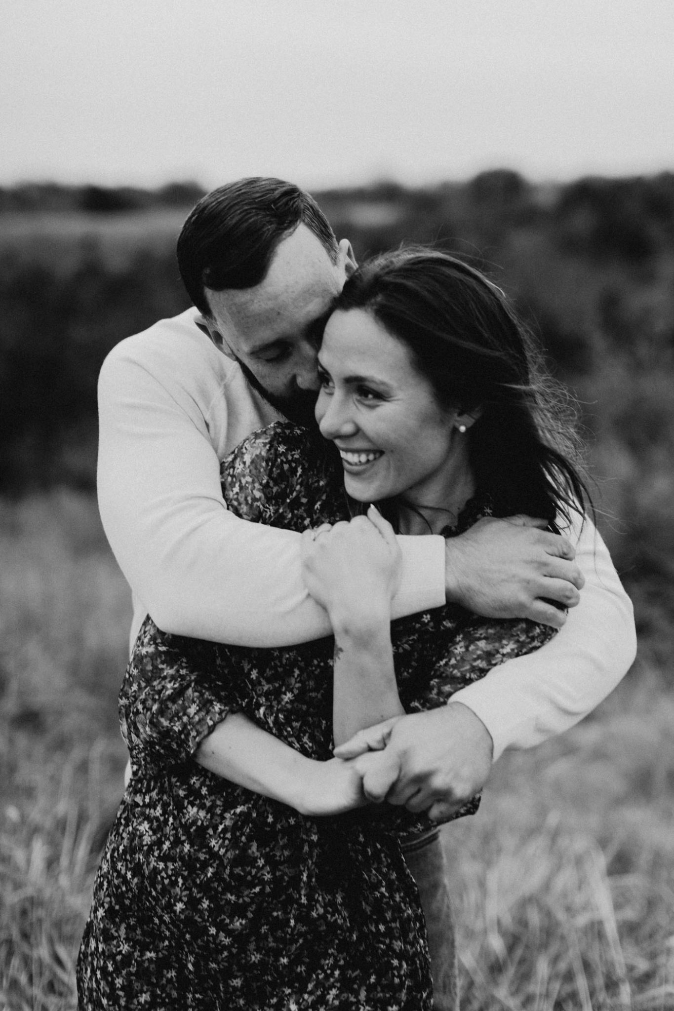 Black and white edit of a photo taken by romantic engagement photographer in Fort Worth
