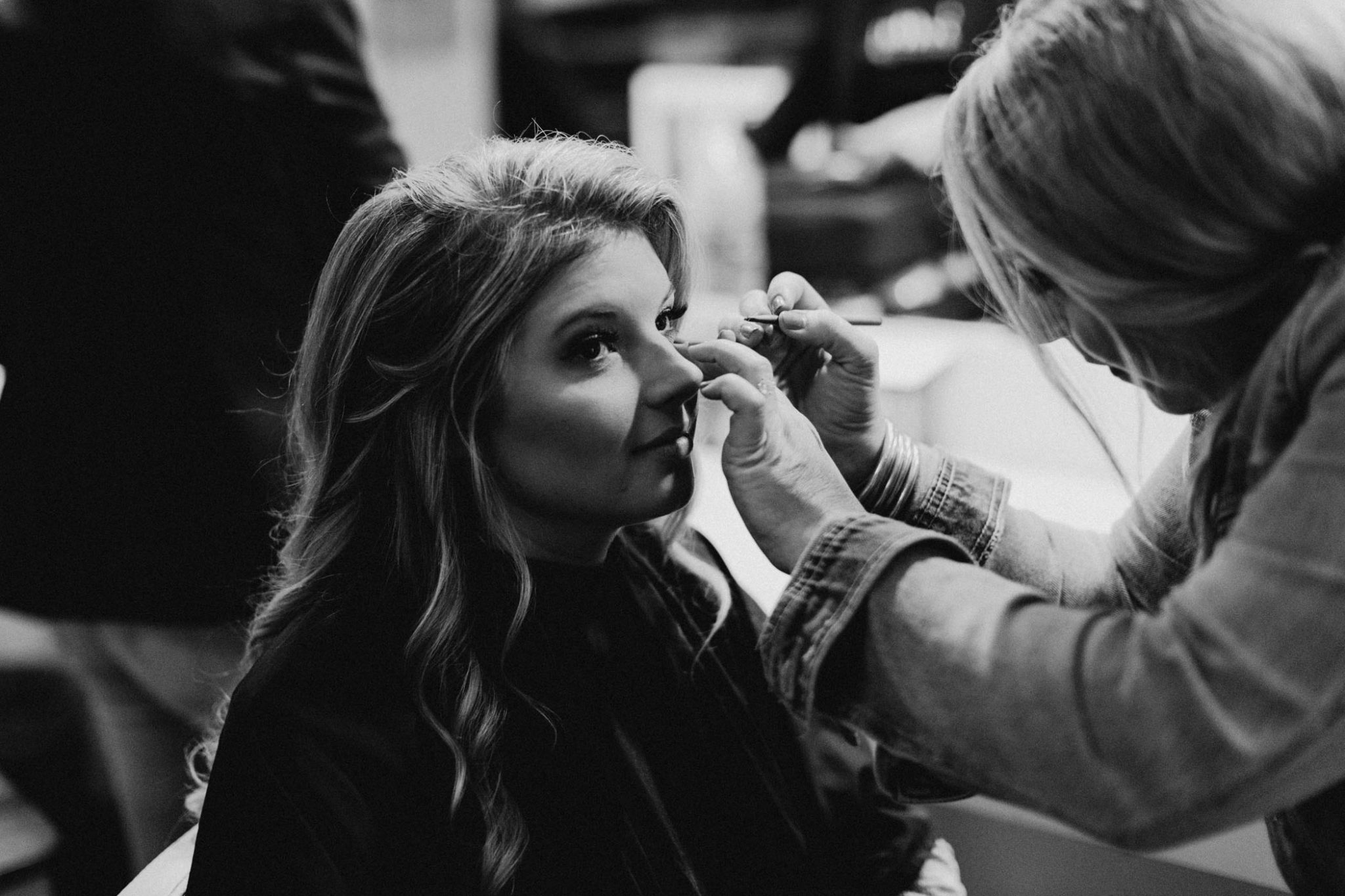 Black and white photo of bride getting ready for her wedding day